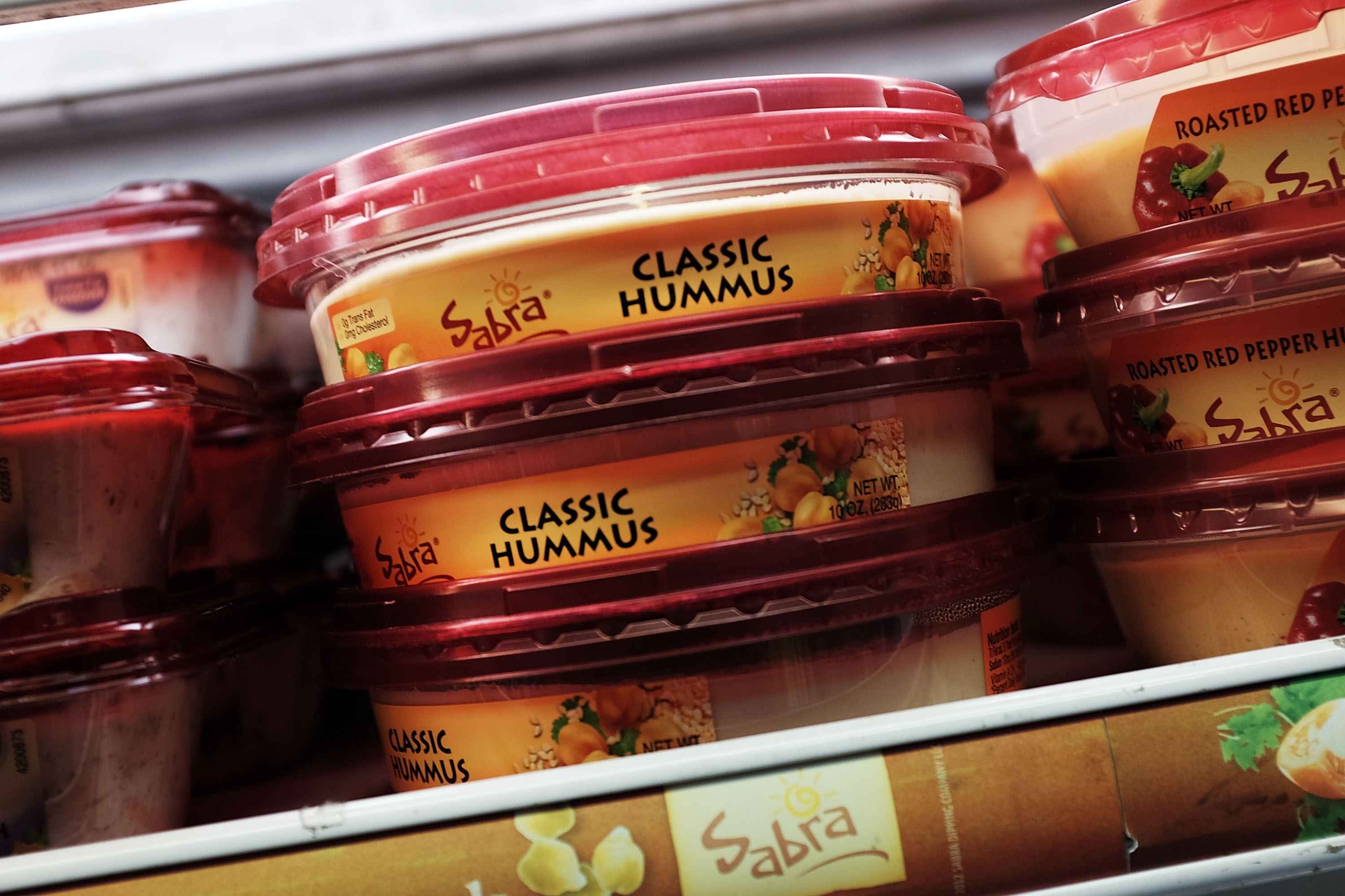 Cases of Sabra Classic Hummus are viewed on the shelf of a grocery store on April 9, 2015 in New York City.