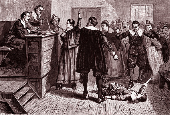 Engraving depicts witchcraft trial.
