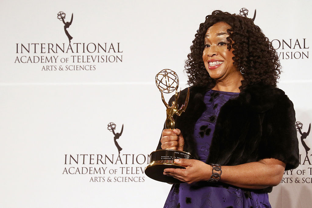 Shonda Rhimes pose with the 'Founders' award in the press room during the 44th International Emmy Awards at New York Hilton on November 21, 2016 in New York City.