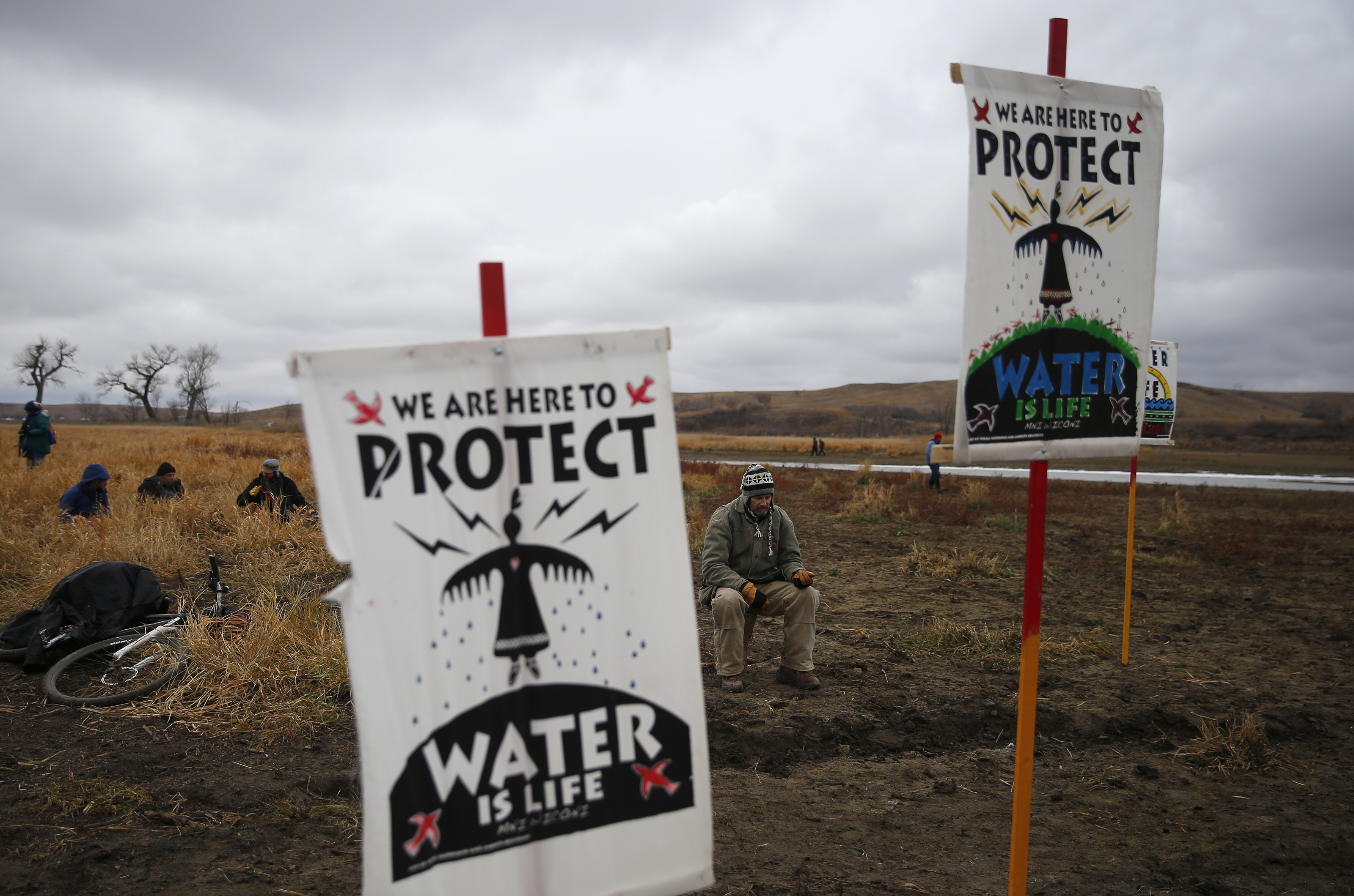 Water protectors protest as police line the hill at Standing Rock on Nov. 24, 2016, during an ongoing dispute over the building of the Dakota Access Pipeline.