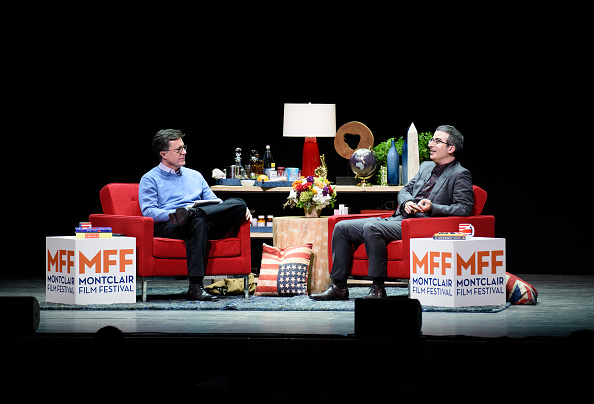 Stephen Colbert(L) and John Oliver (R) onstage at the Post-Election Evening to Benefit Montclair Film Festival at NJ Performing Arts Center on November 19, 2016 in Newark, New Jersey.