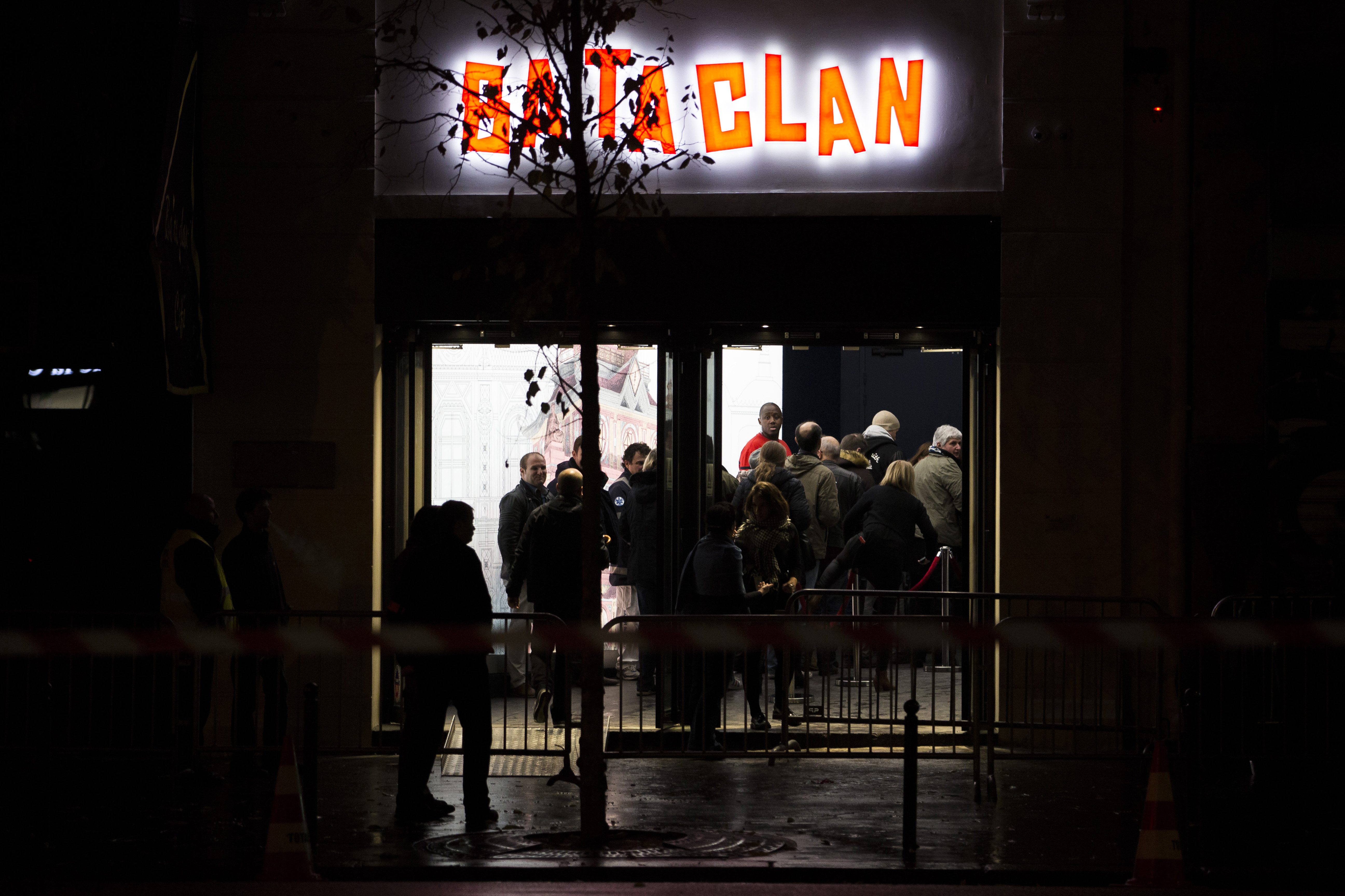 People enter the Bataclan concert hall in Paris, on Nov. 12, 2016. A concert by British pop legend Sting is marking the reopening of the Paris' Bataclan.