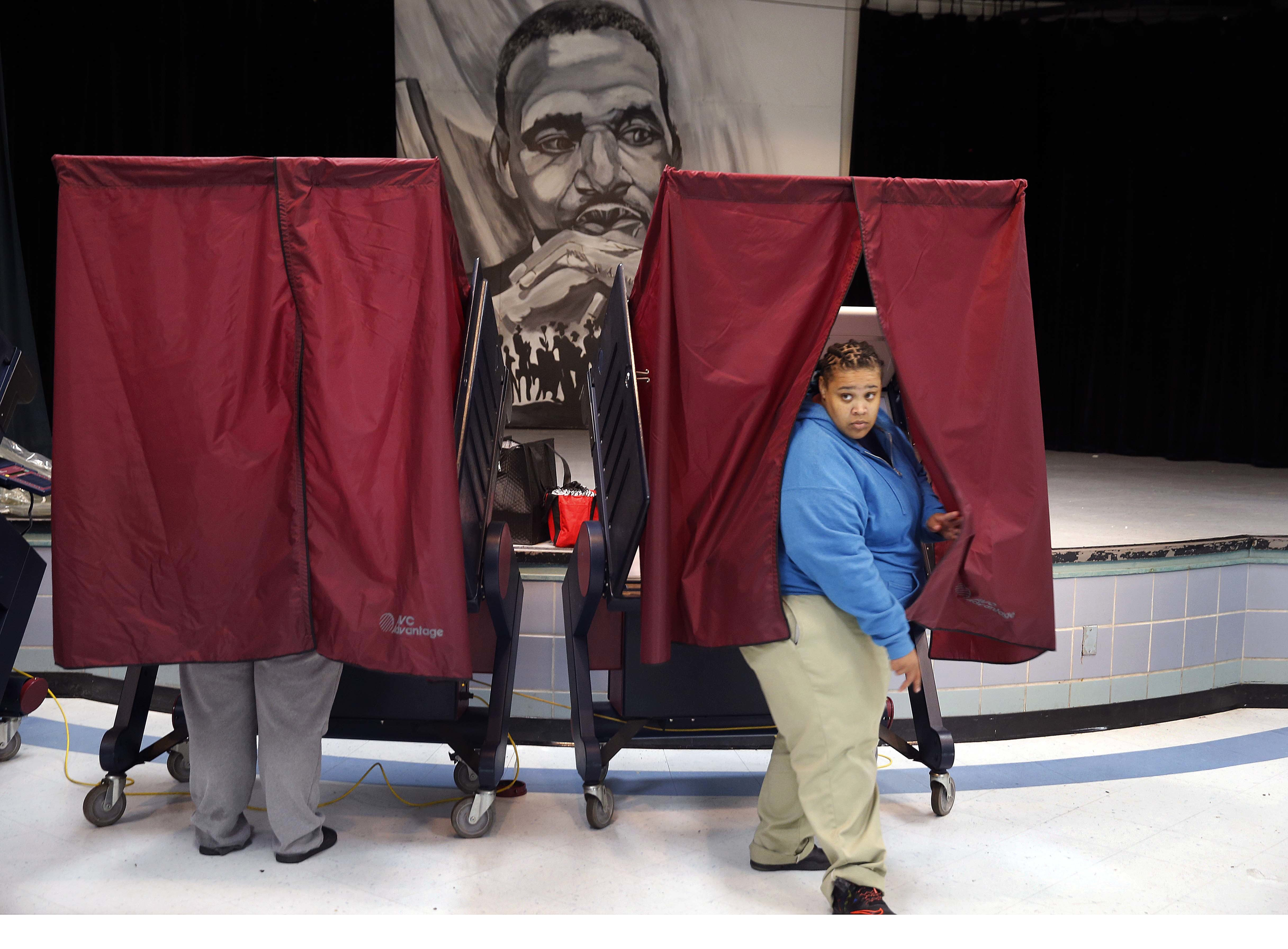 Ronique Slack exits a polling booth after casting her vote on Election Day at the Martin Luther King, Jr. Charter School in the Lower 9th Ward of New Orleans.