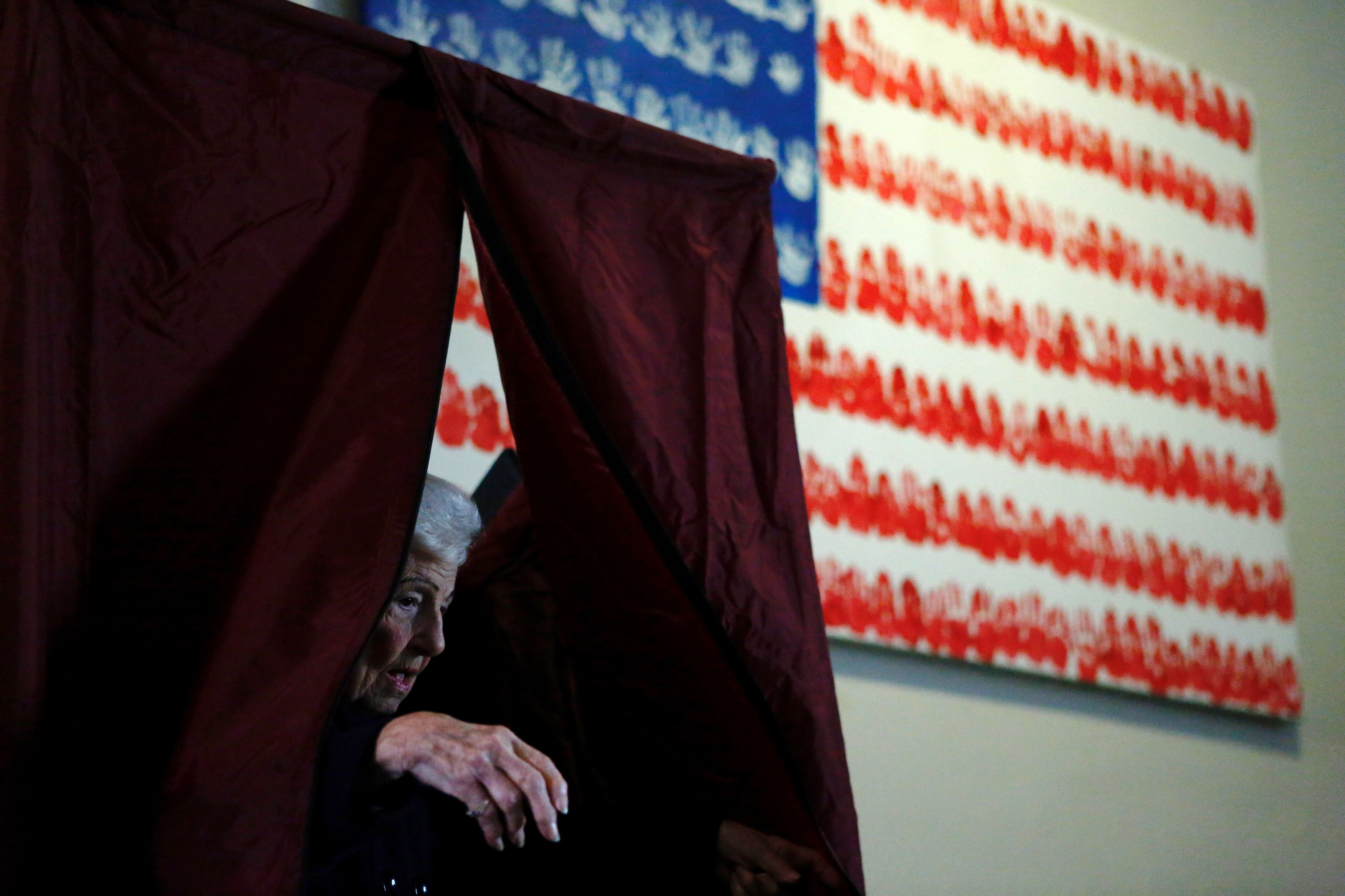 A woman exits a polling station after voting in Newport, New Jersey.