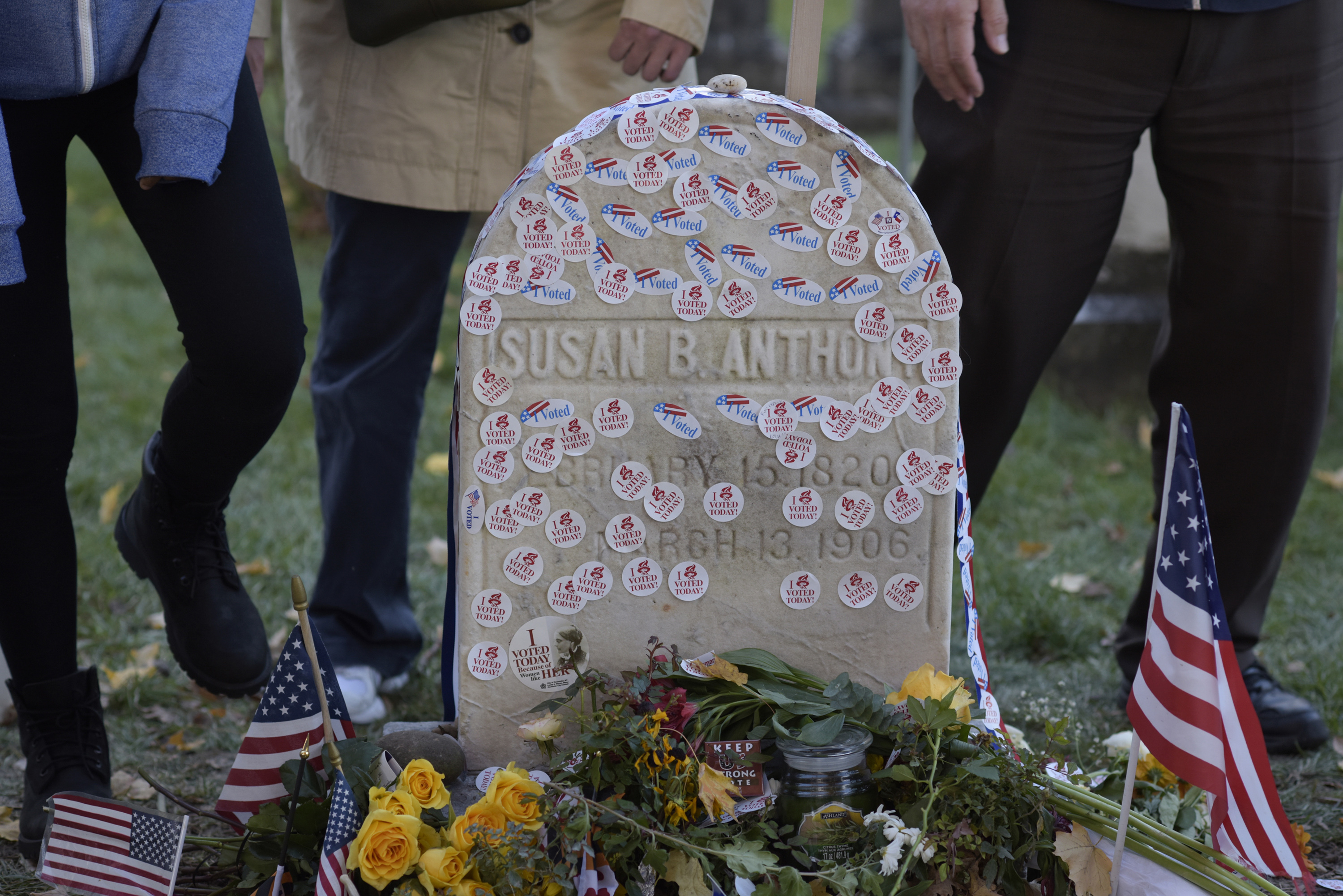 People visit the grave of women's suffrage leader Susan B. Anthony at Mount Hope Cemetery in Rochester, New York.