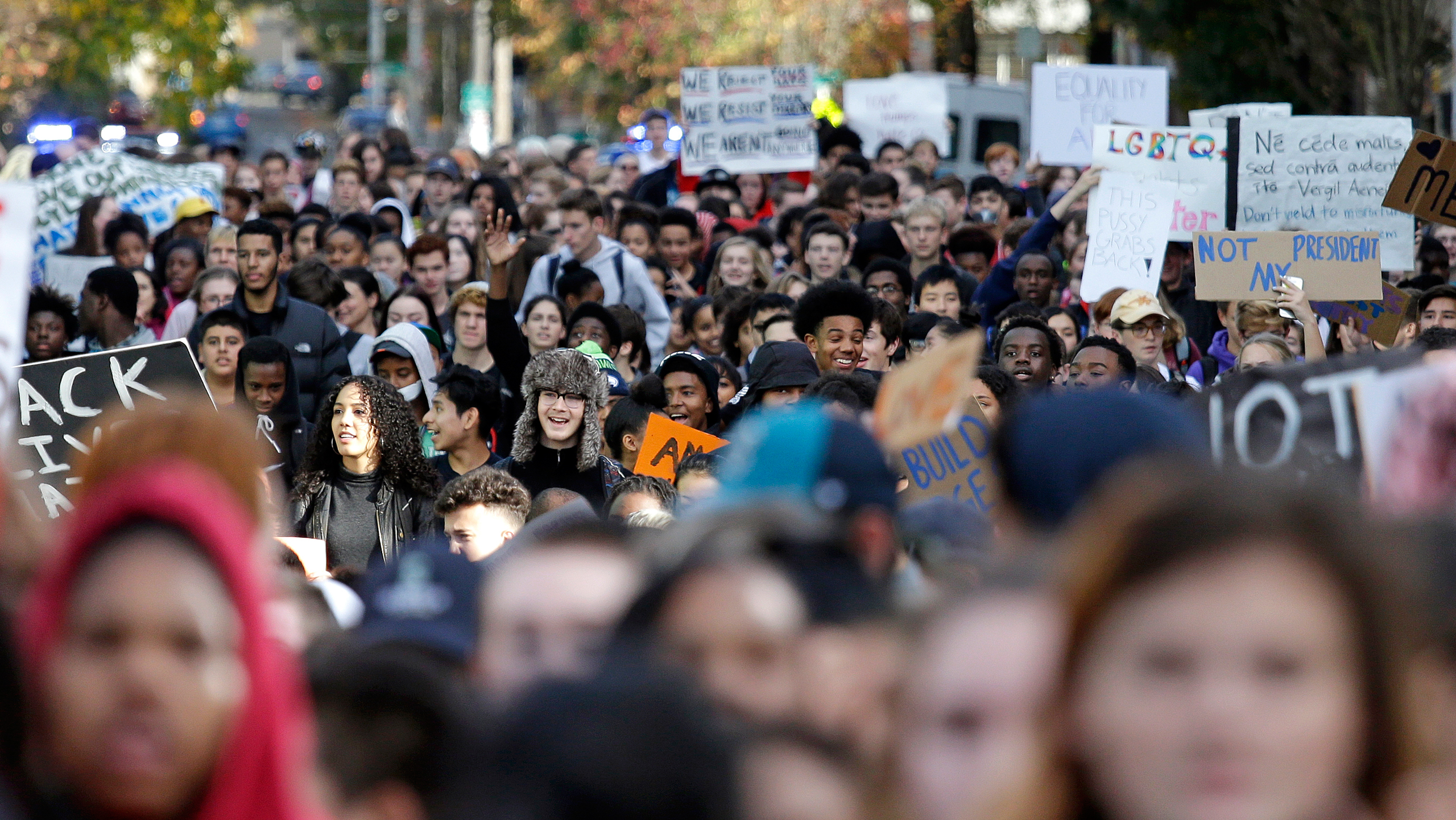 High school students fill a street as they head to join others during a walkout to protest the election of Donald Trump as president in Seattle on Nov. 14, 2016.