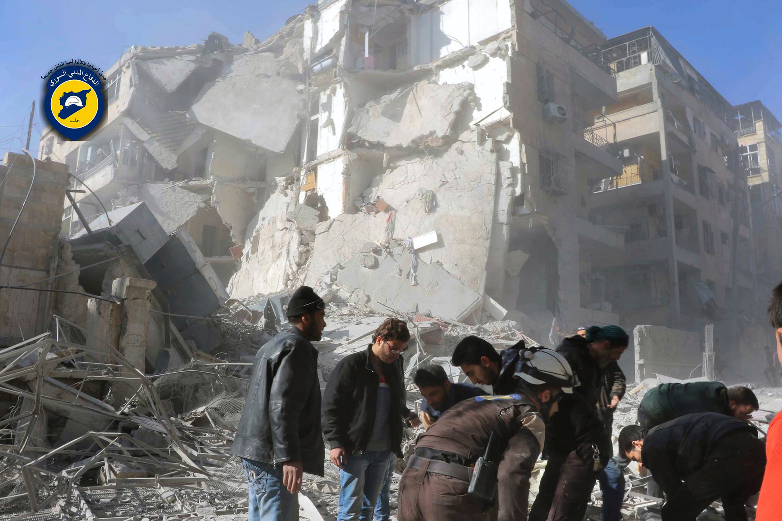 Civil Defense workers and Syrian citizens inspect damage buildings after airstrikes hit the Seif al-Dawleh neighborhood in Aleppo, Syria, on Nov. 19, 2016.