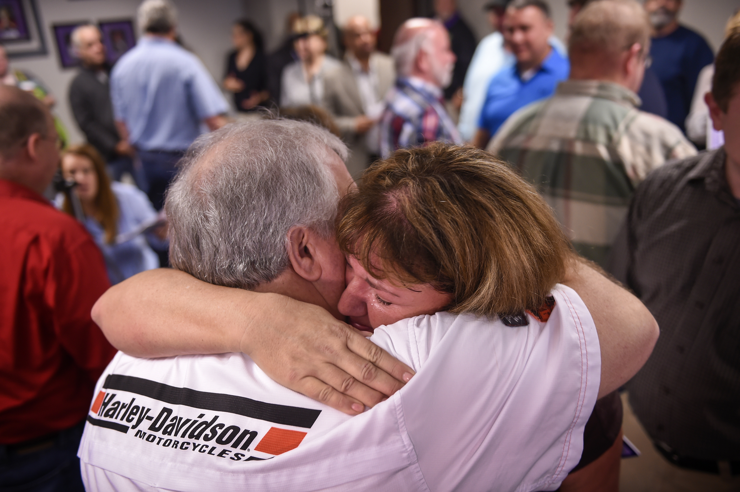 Amy O'Neal cries as she hugs co-worker and fellow lottery winner Larry Estes at the Tennessee Lottery Headquarters in Nashville, on Nov. 29, 2016. in Nashville.