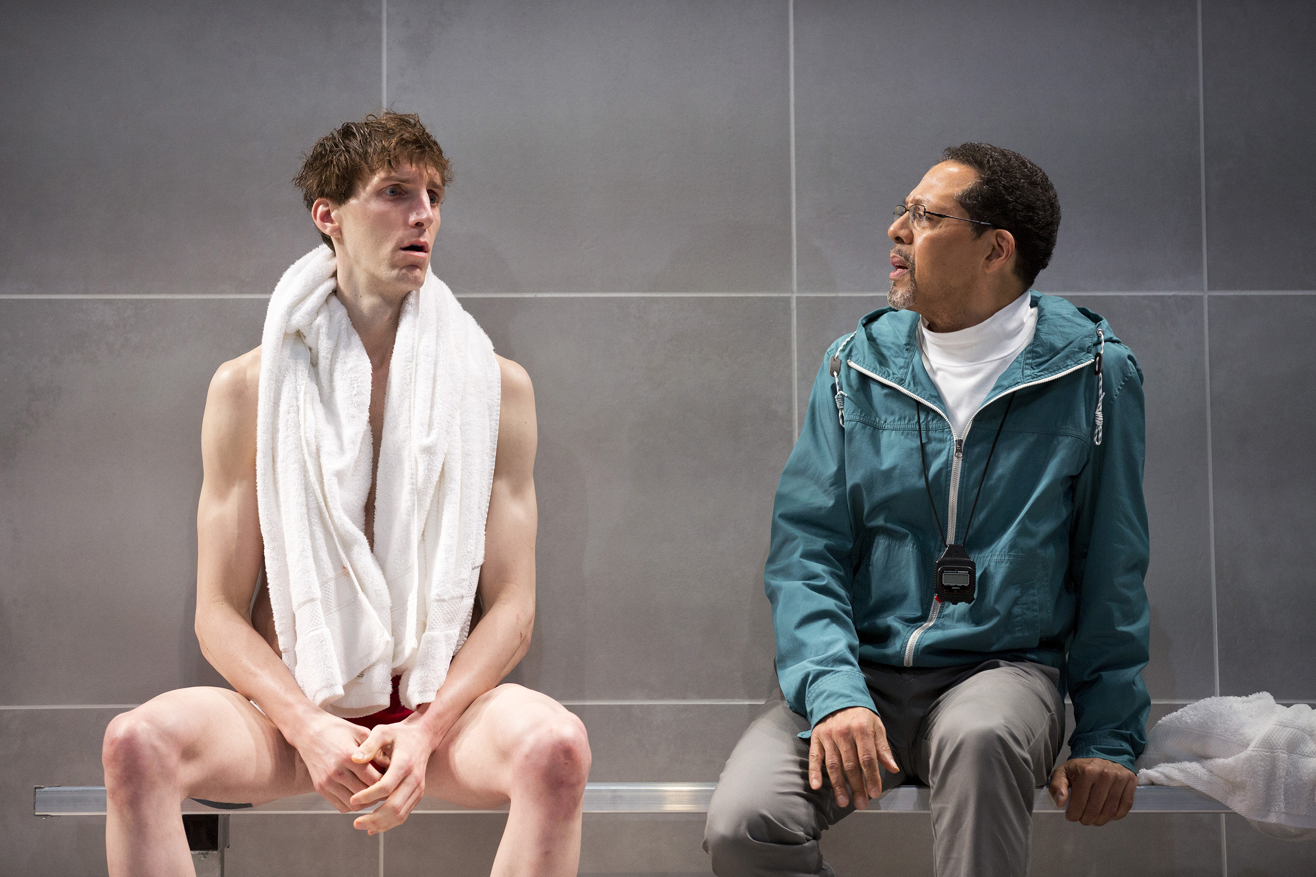 Alex Breaux, left, and Peter Jay Fernandez in a scene from the play  Red Speedo  at the New York Theater, Feb. 10, 2016. Breaux, formerly a Harvard wide receiver who opted for an acting career, plays a champion swimmer in the play. (Sara Krulwich/The New York Times)