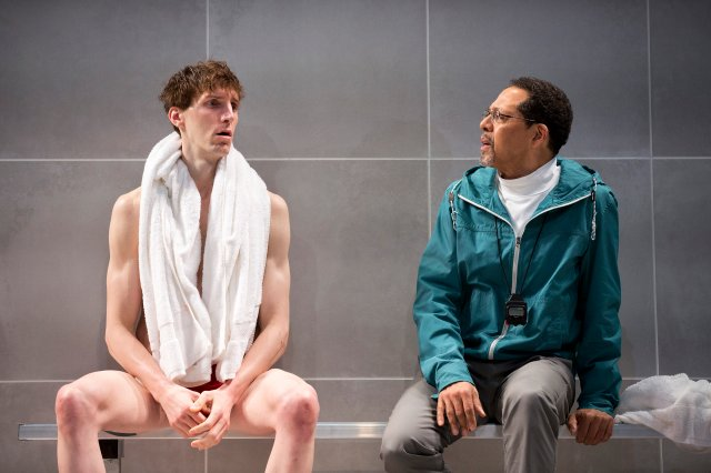 "Alex Breaux, left, and Peter Jay Fernandez in a scene from the play ""Red Speedo"" at the New York Theater, Feb. 10, 2016. Breaux, formerly a Harvard wide receiver who opted for an acting career, plays a champion swimmer in the play. (Sara Krulwich/The New York Times)"