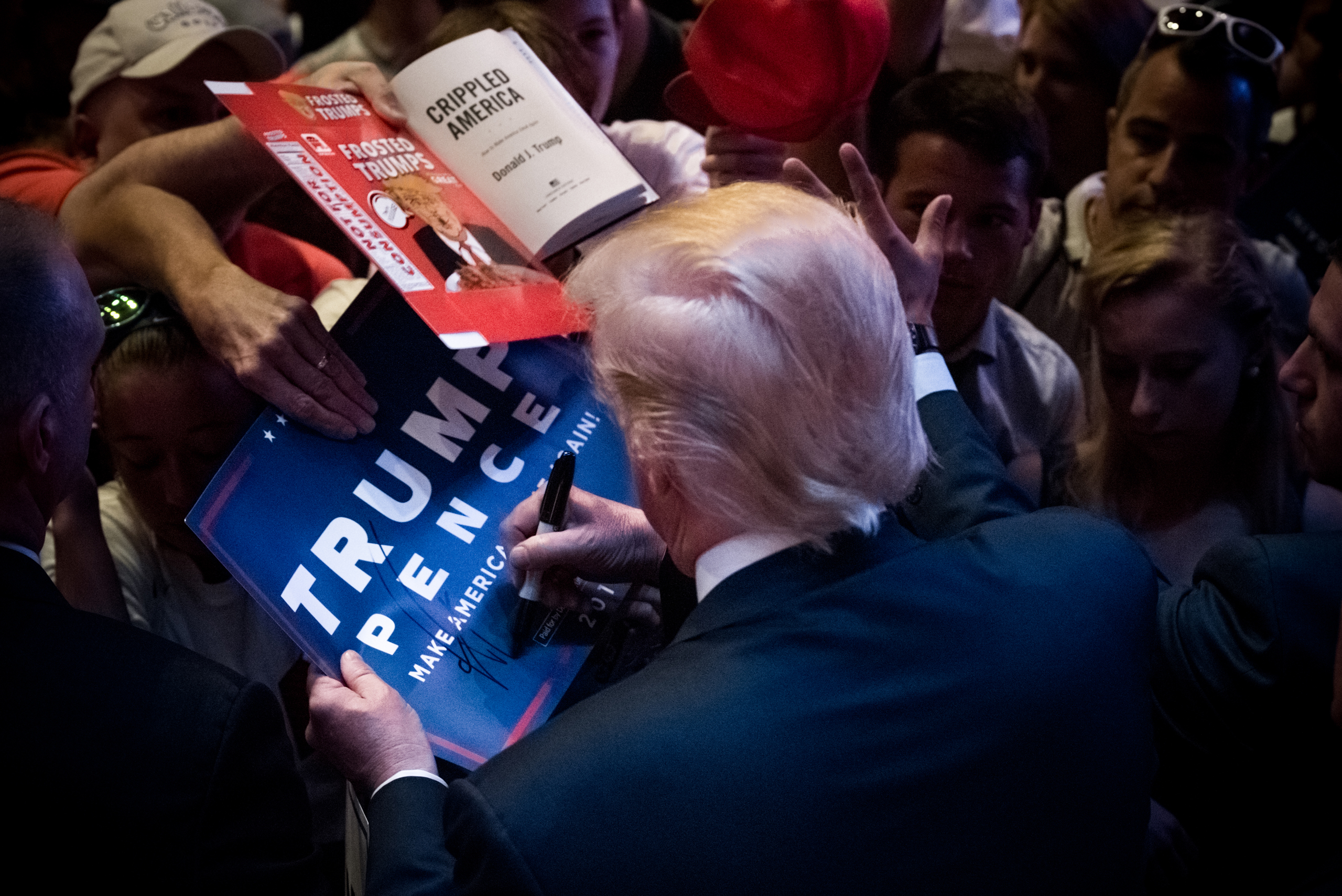 Donald J. Trump signs memorabilia while campaigning in Portland, Maine, on Aug. 4, 2016.