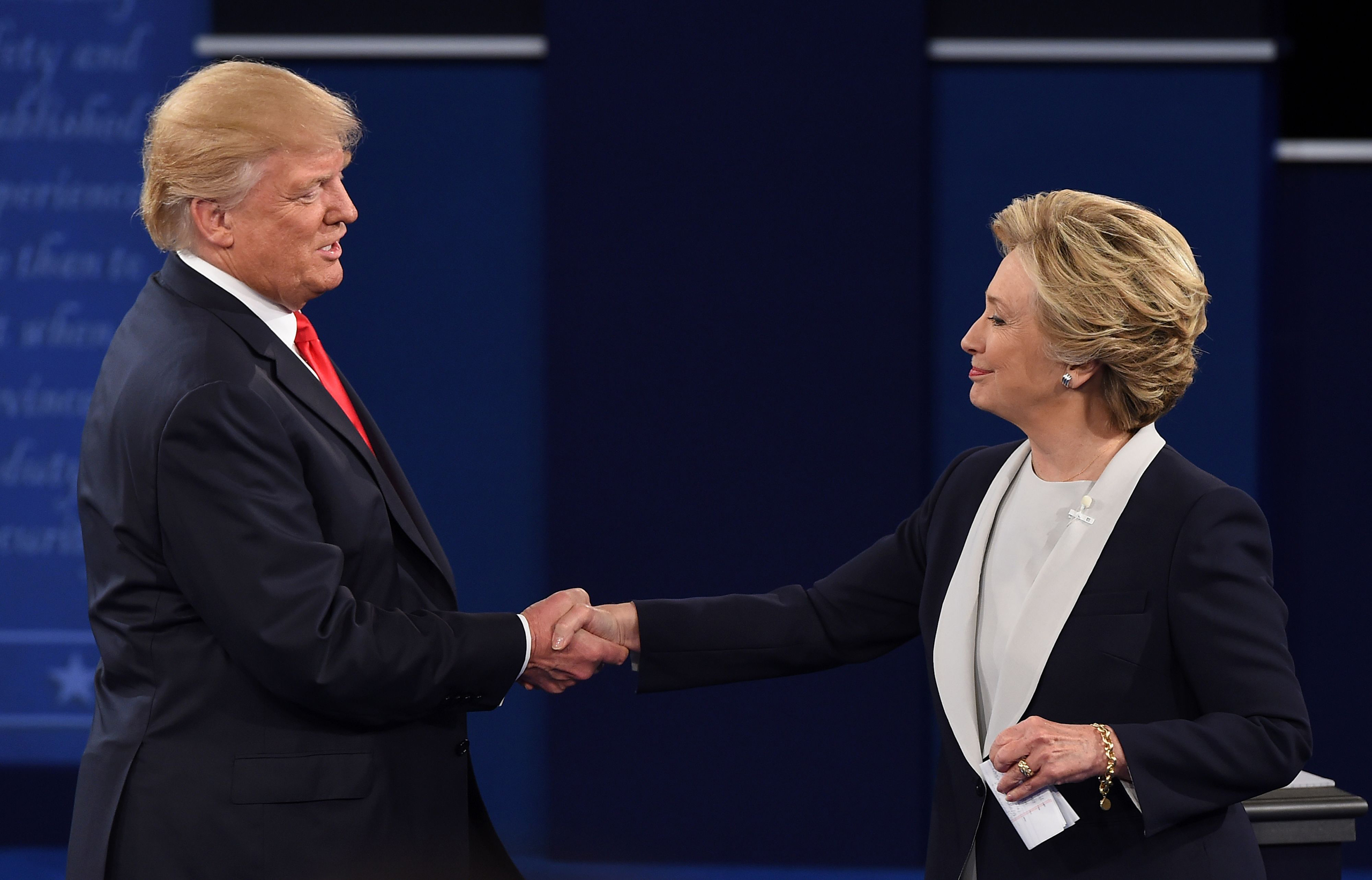 Hillary Clinton and Donald Trump shake hands after the second presidential debate at Washington University in St. Louis, Missouri, on Oct. 9, 2016.