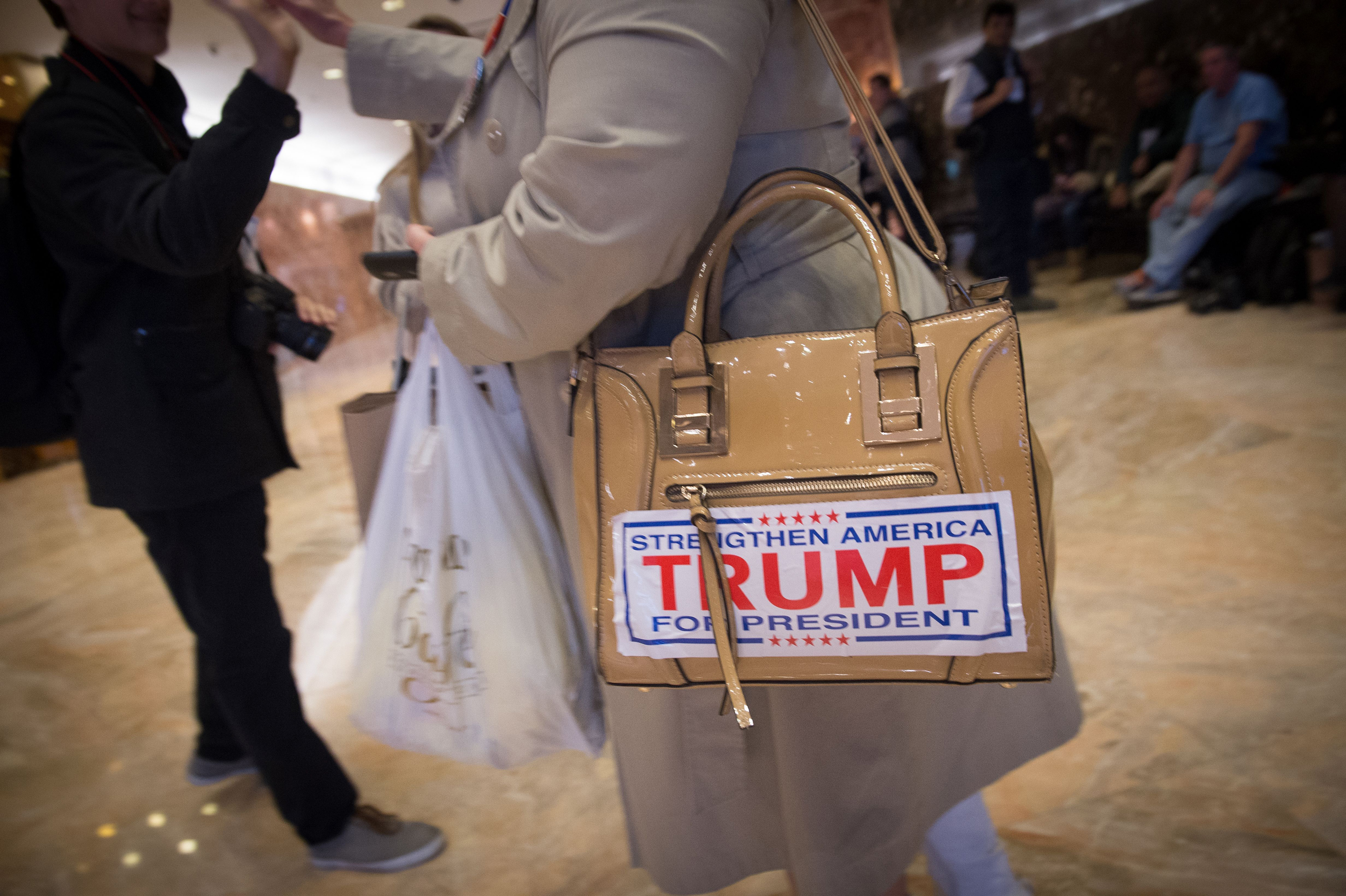 A supporter of US President-elect Donald Trump walks through the lobby of Trump Tower on Fifth Avenue, on Nov. 13, 2016.