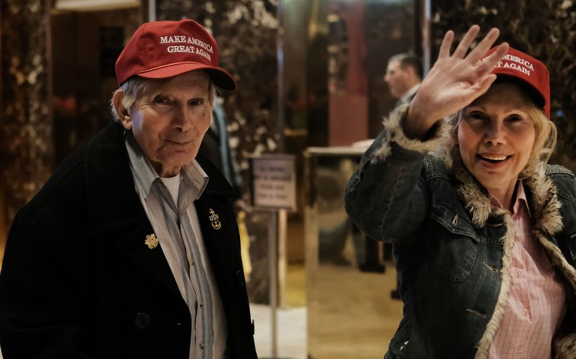 Donald Trump supporters walk through the lobby of Trump Tower as the media congregates in the lobby on Nov. 18, 2016.