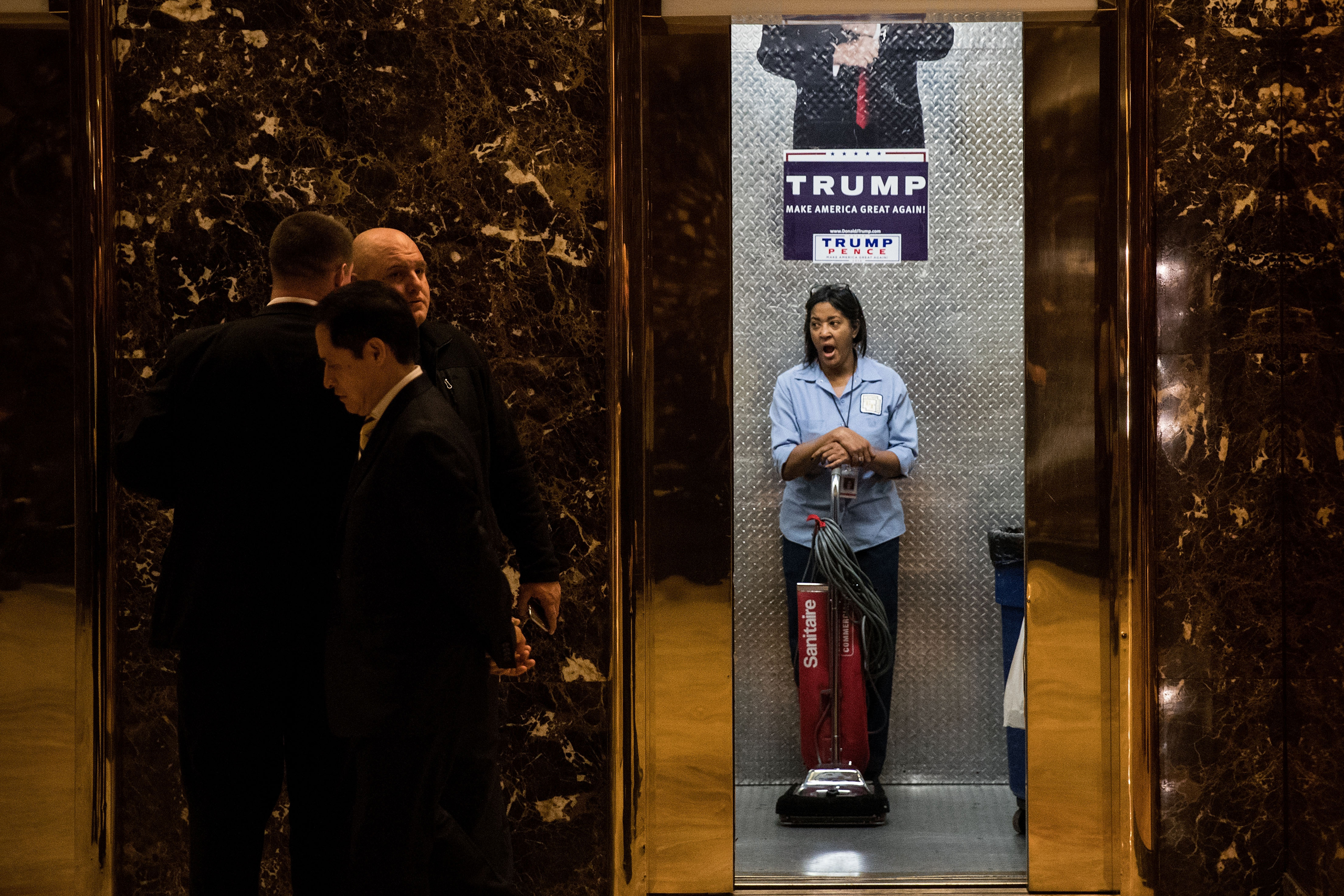 A maintenance worker yawns as she stands in an elevator in the lobby at Trump Tower, on Nov. 14, 2016.