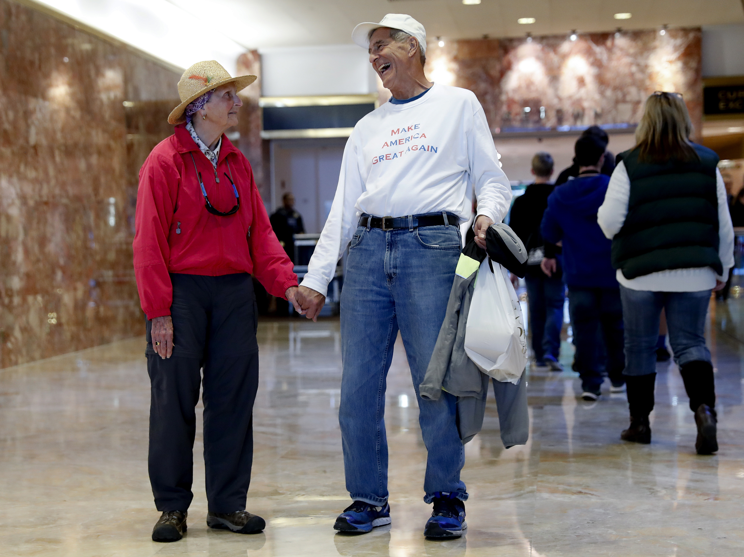 President-elect Donald Trump supporters Tom and Barbara Bechler of Calif., stand hand-in-hand as they visit the lobby of Trump Tower, on Nov. 17, 2016.