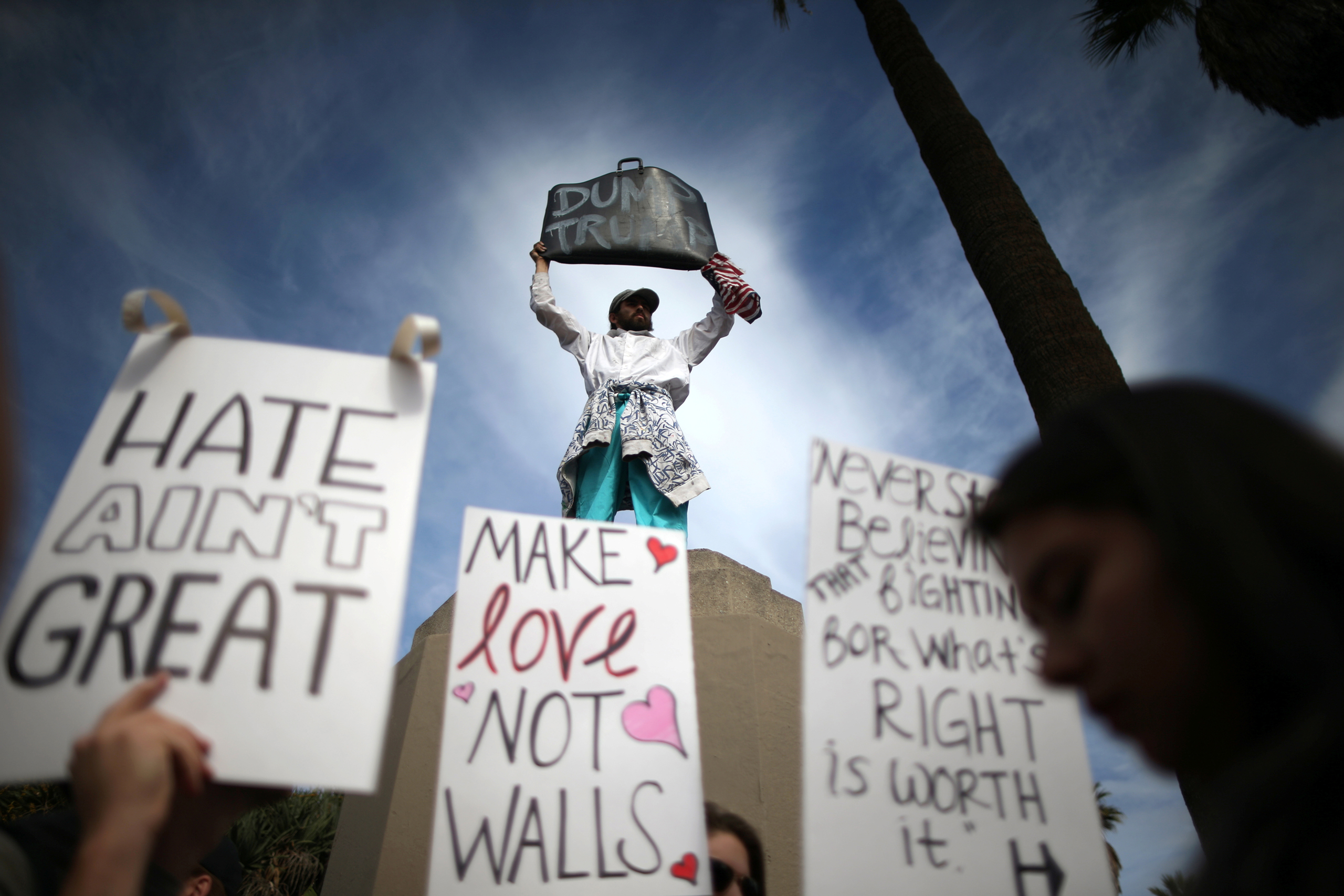 People hold signs during a march and rally against the election of Republican Donald Trump as President of the United States in Los Angeles on Nov. 12, 2016.