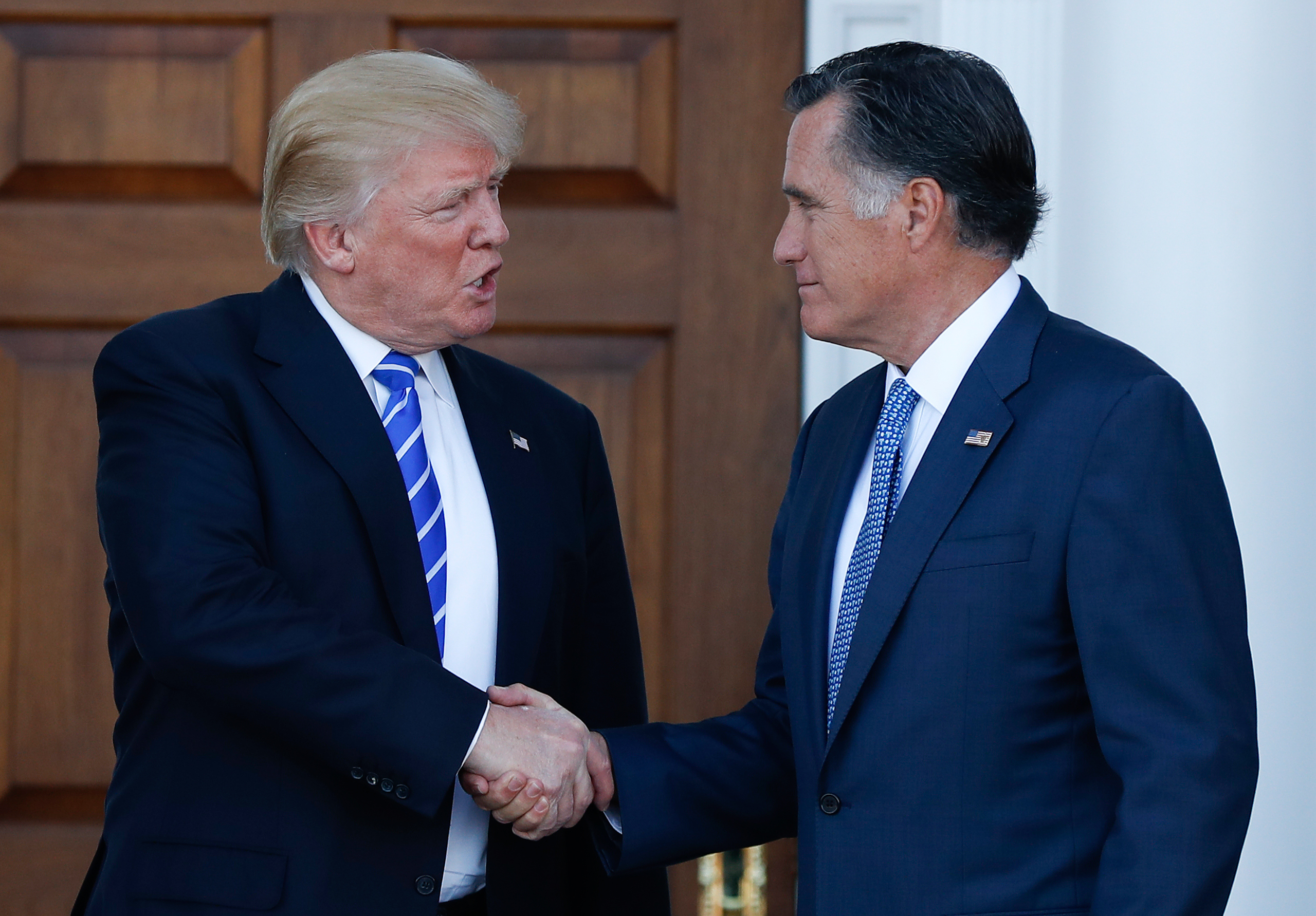 President-elect Donald Trump and Mitt Romney shake hands as Romney leaves Trump National Golf Club Bedminster in Bedminster, N.J., on Nov. 19, 2016.