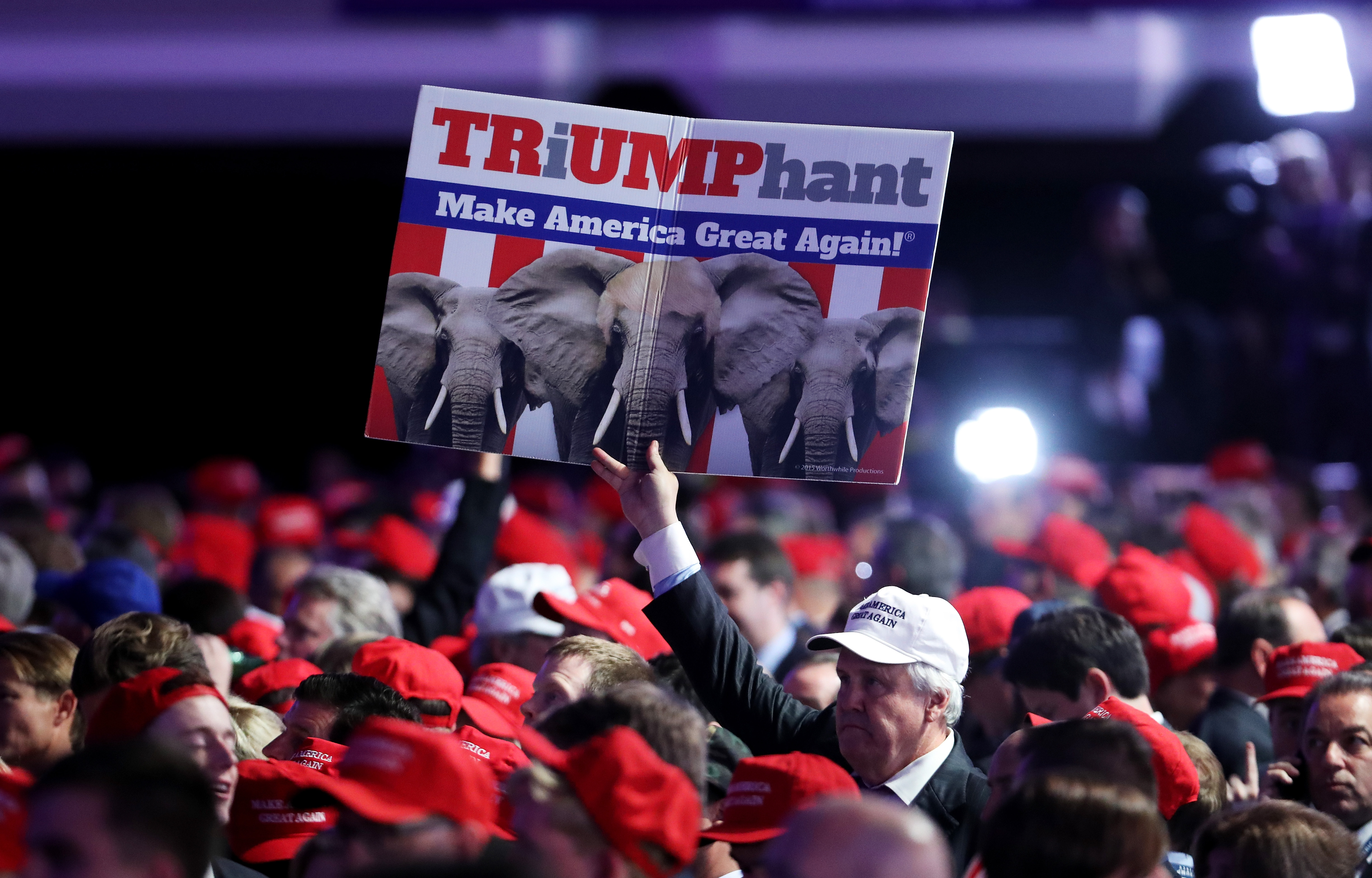 A supporter holds up a sign in support of Republican presidential nominee Donald Trump during the election night event at the New York Hilton Midtown on Nov. 8, 2016.