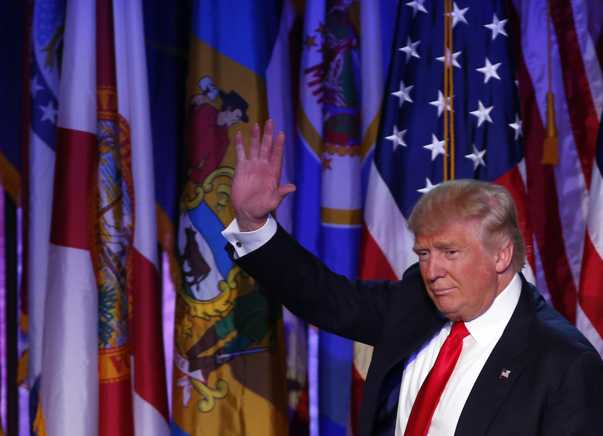 Donald Trump waves to the crowd after addressing his supporters and celebrating his Presidential win at his election night event at the New York Hilton Midtown in New York