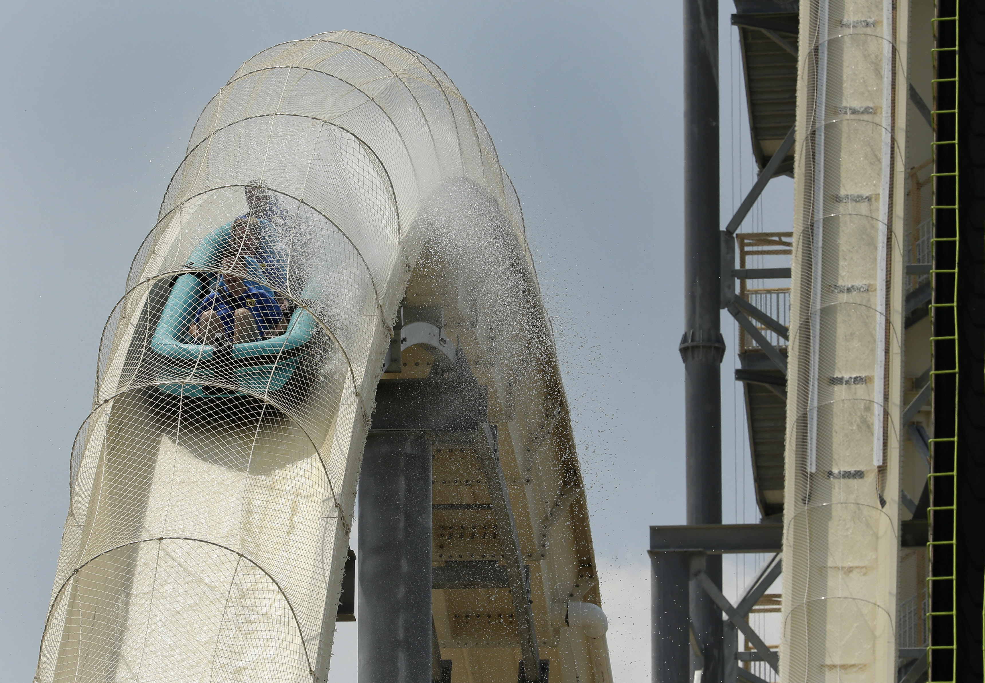 Riders are propelled by jets of water as the go over a hump while riding the world's tallest water slide called  Verruckt  at Schlitterbahn Waterpark, on July 9, 2014, in Kansas City, Kan.
