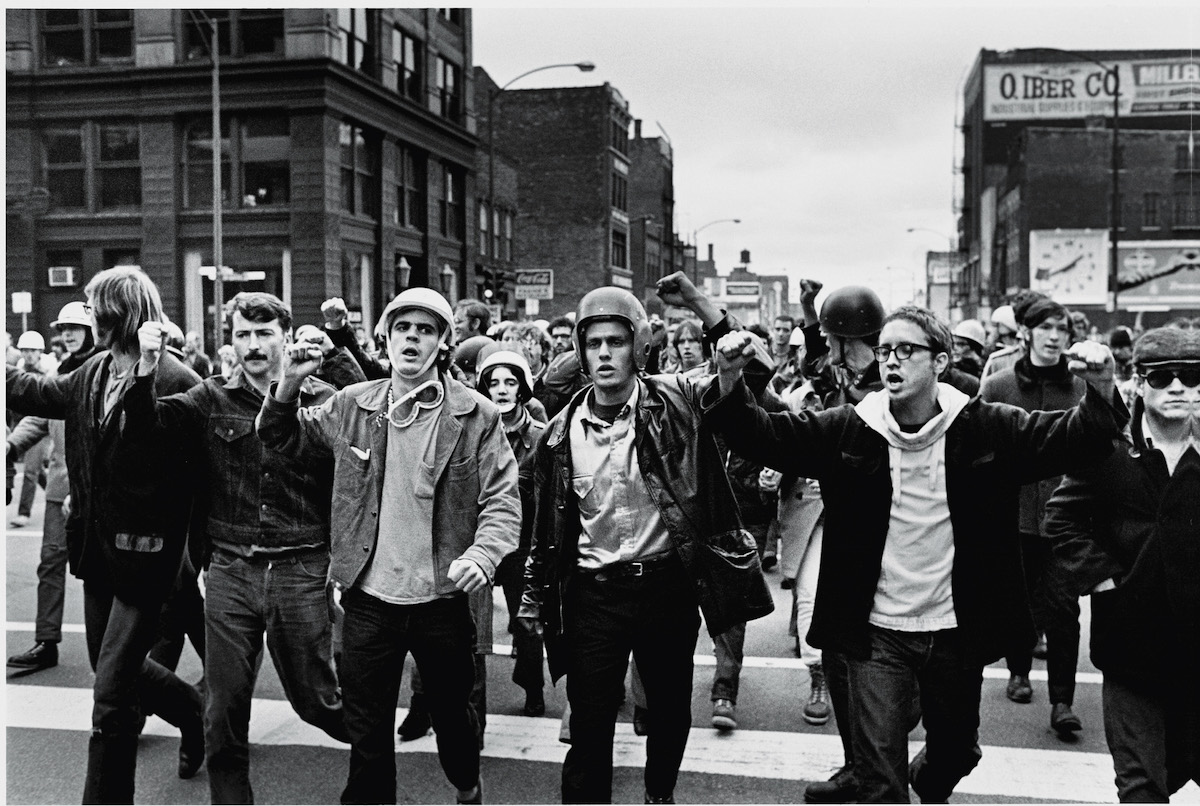Leaders of the radical American student group the Weathermen, (left to right) Jim Mellen, Peter Clapp, John Jacobs, Bill Ayers, and Terry Robbins, march in 1969 at the van of a group of demonstrators during the 'Days of Rage' actions organized by the Weathermen to protest the trial of the Chicago Seven and 'to bring the war home.'