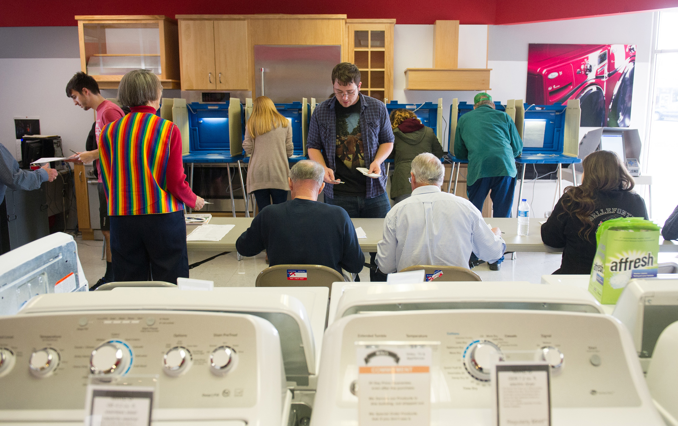 Voters cast their ballots in a polling location inside Mike's TV and Appliance  Nov. 8, 2016 in State College, Pennsylvania.