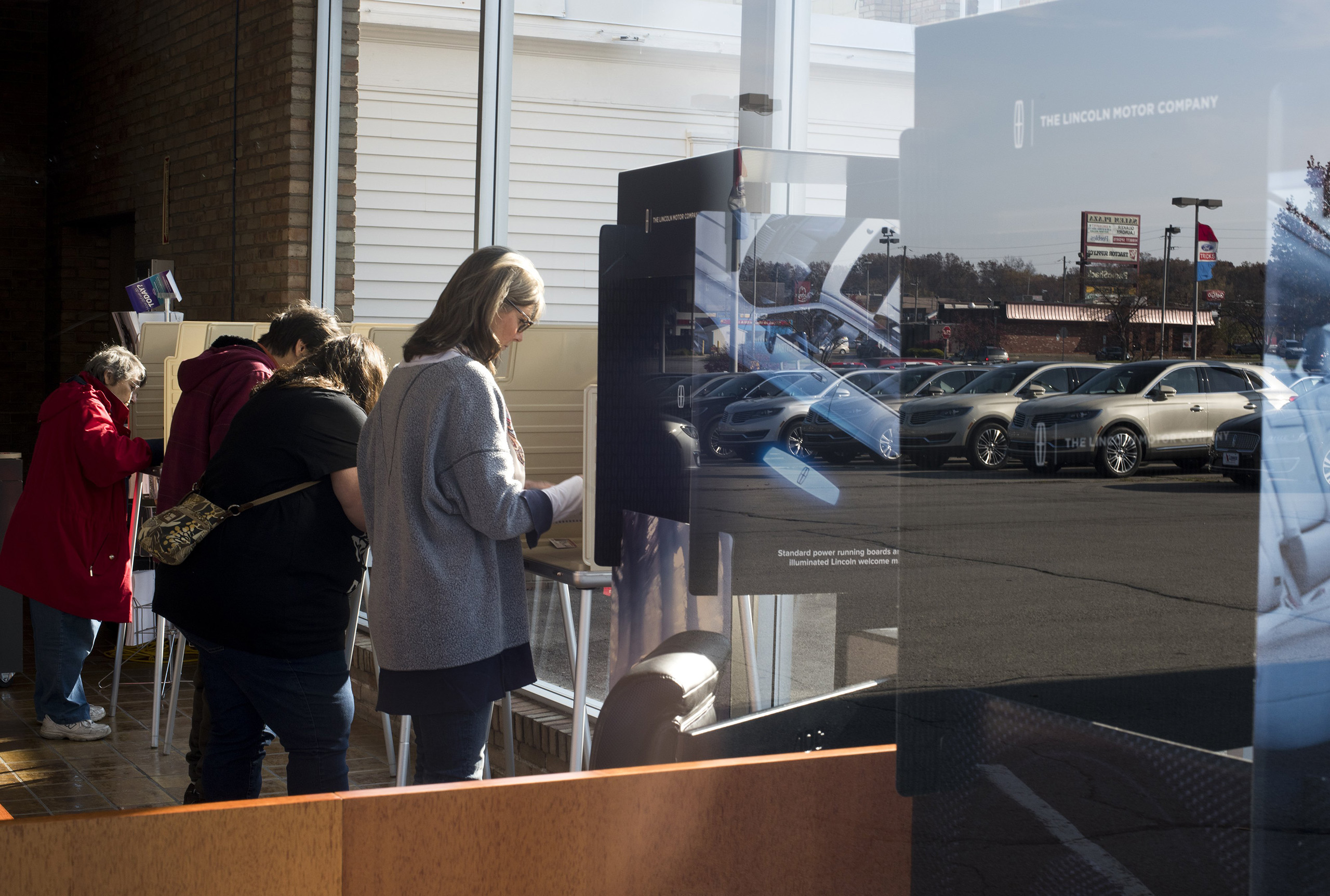 Voters cast their ballots at the Donnell Ford car dealership on Nov. 8, 2016 in Salem, Ohio.