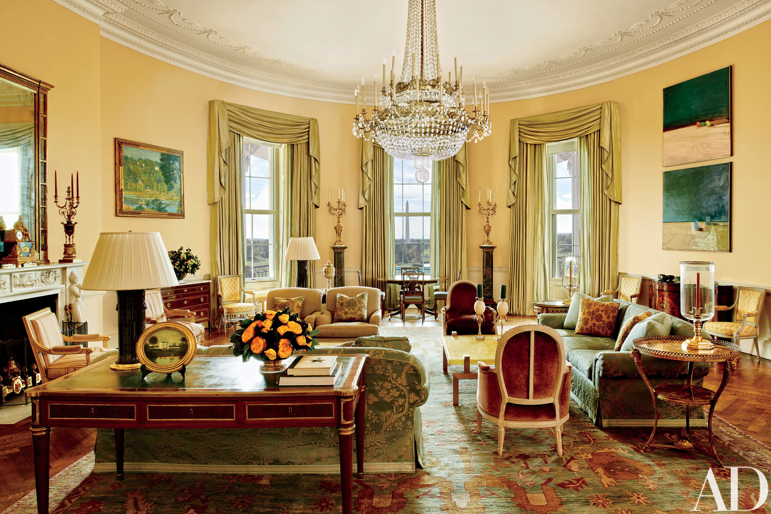 The Yellow Oval Room in the White House in Washington. Designer Michael S. Smith specified a Donald Kaufman paint for the Yellow Oval Room. Artworks by Paul Cézanne and Daniel Garber flank the mantel. Smith mellowed the Yellow Oval Room with smoky browns, greens, golds, and blues. The 1978 Camp David peace accords were signed at the antique Denis-Louis Ancellet desk, front left.