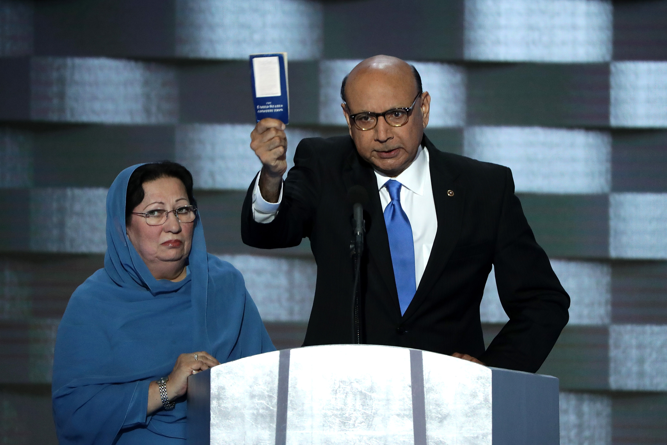 Khizr Khan, father of deceased Muslim U.S. Soldier Humayun S. M. Khan, holds up a booklet of the US Constitution as he delivers remarks on the fourth day of the Democratic National Convention at the Wells Fargo Center in Philadelphia, Pennsylvania, on July 28, 2016.