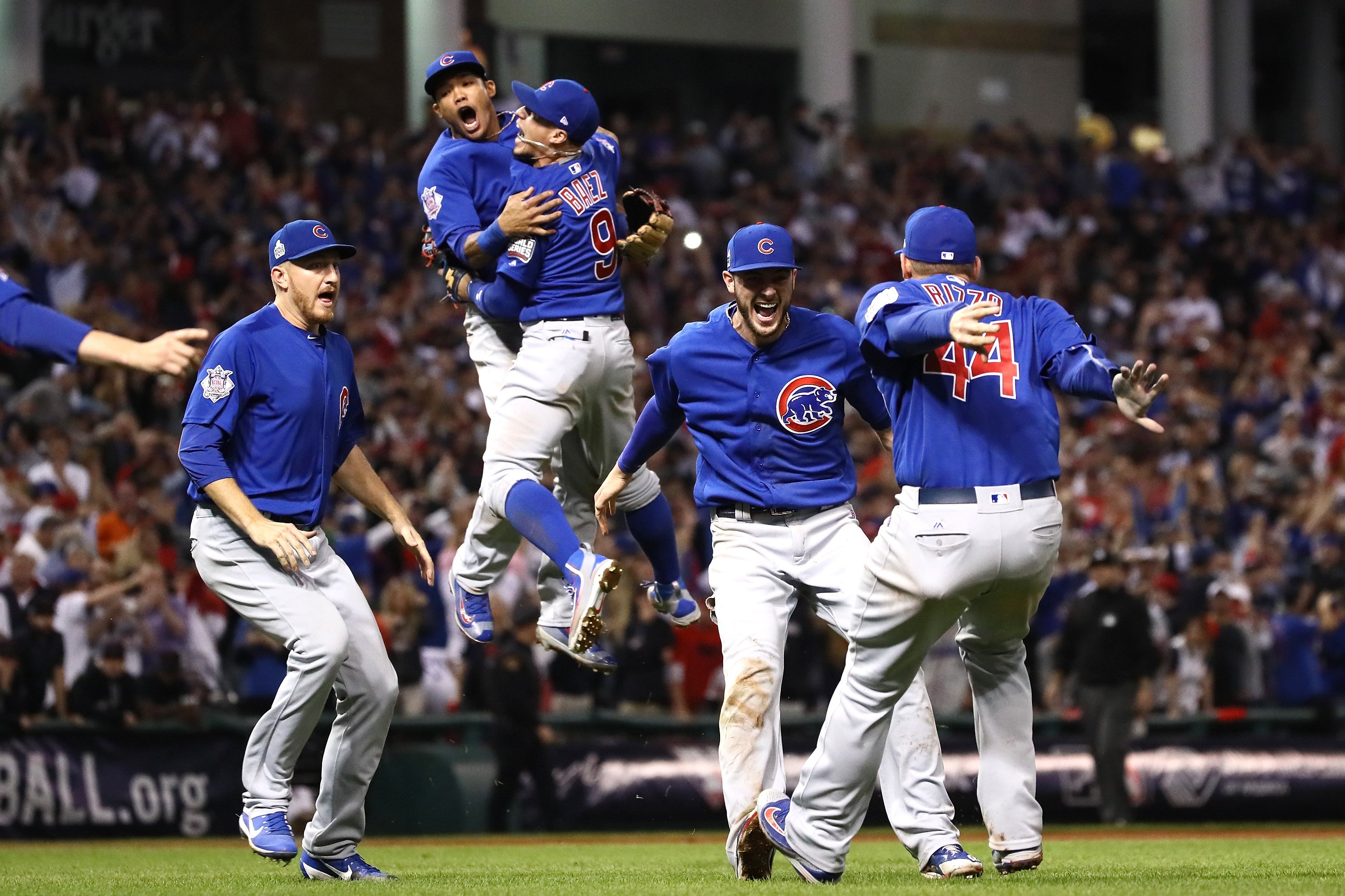 The Chicago Cubs celebrate after defeating the Cleveland Indians  8-7 in Game 7 to win baseball's 2016 World Series at Progressive Field on Nov. 3, 2016 in Cleveland.