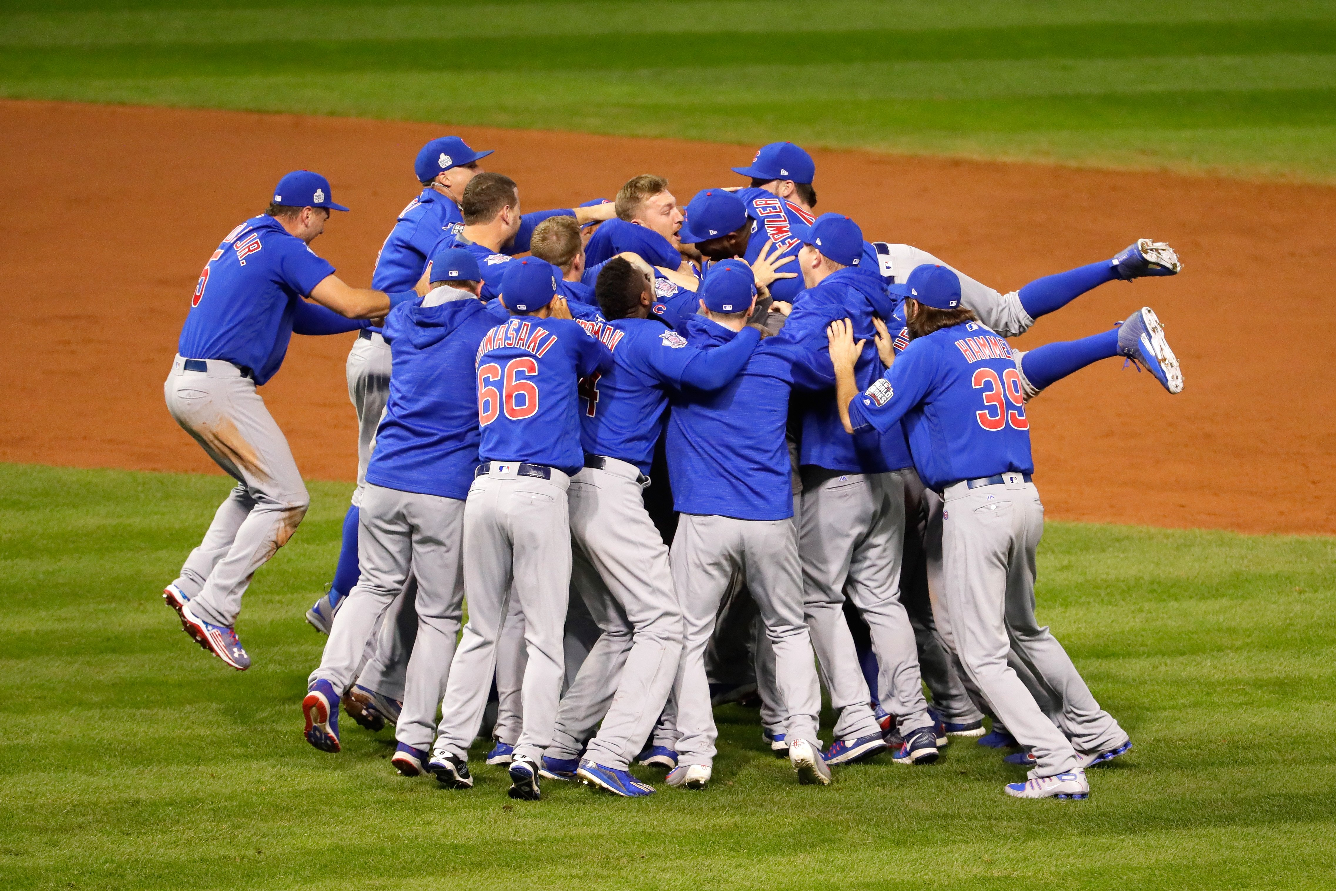 The Chicago Cubs celebrate after defeating the Cleveland Indians  8-7 in Game 7 to win baseball's 2016 World Series at Progressive Field on Nov. 2, 2016 in Cleveland.