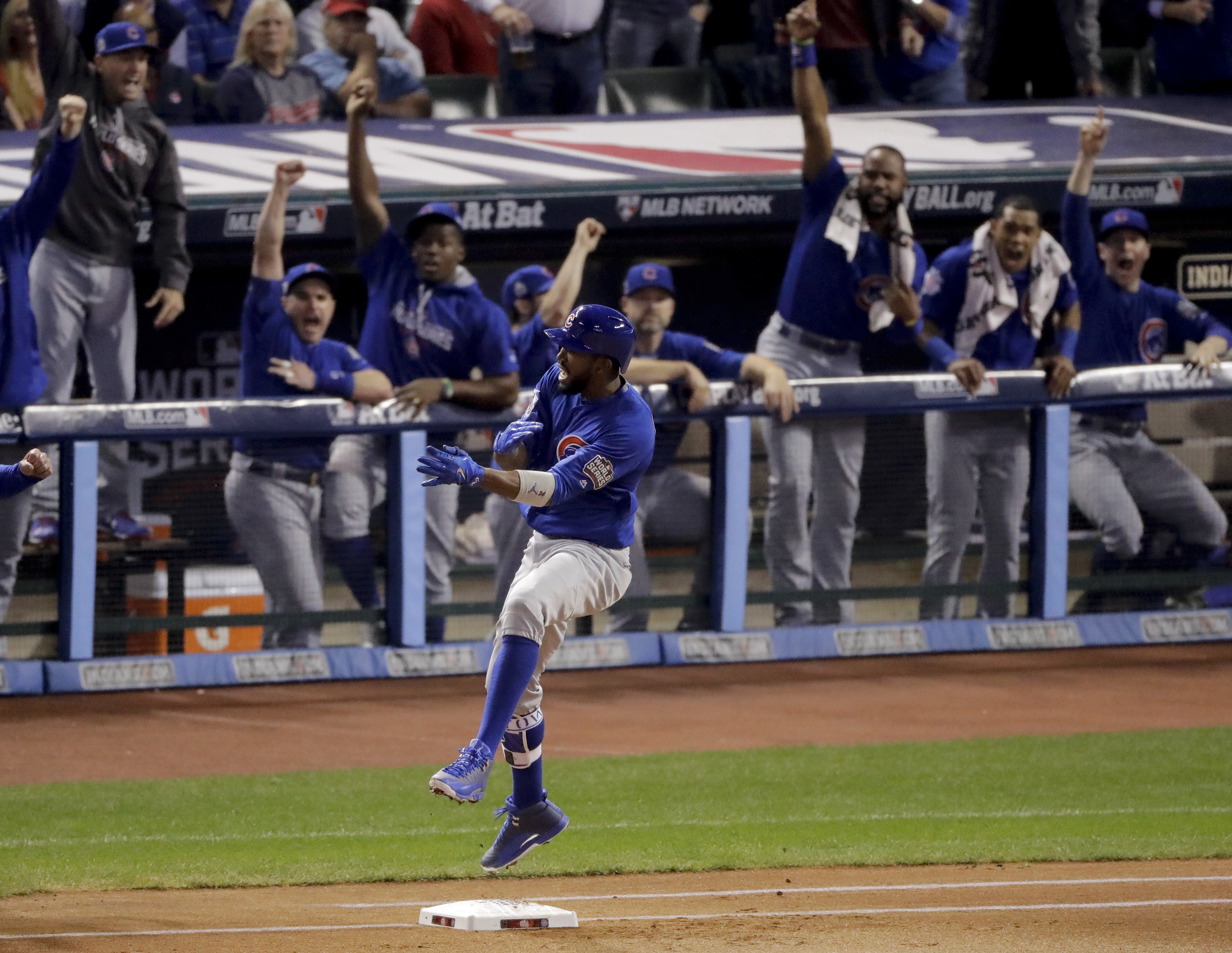 Chicago Cubs' Dexter Fowler celebrates after a leadoff home run against the Cleveland Indians during the first inning of Game 7 of the Major League Baseball World Series Wednesday, Nov. 2, 2016, in Cleveland.