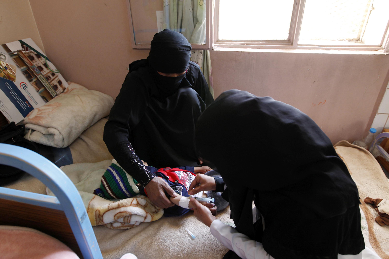 A Yemeni doctor injects a baby at a Kuwaiti hospital on November 6, 2016 in the Yemeni capital Sanaa.