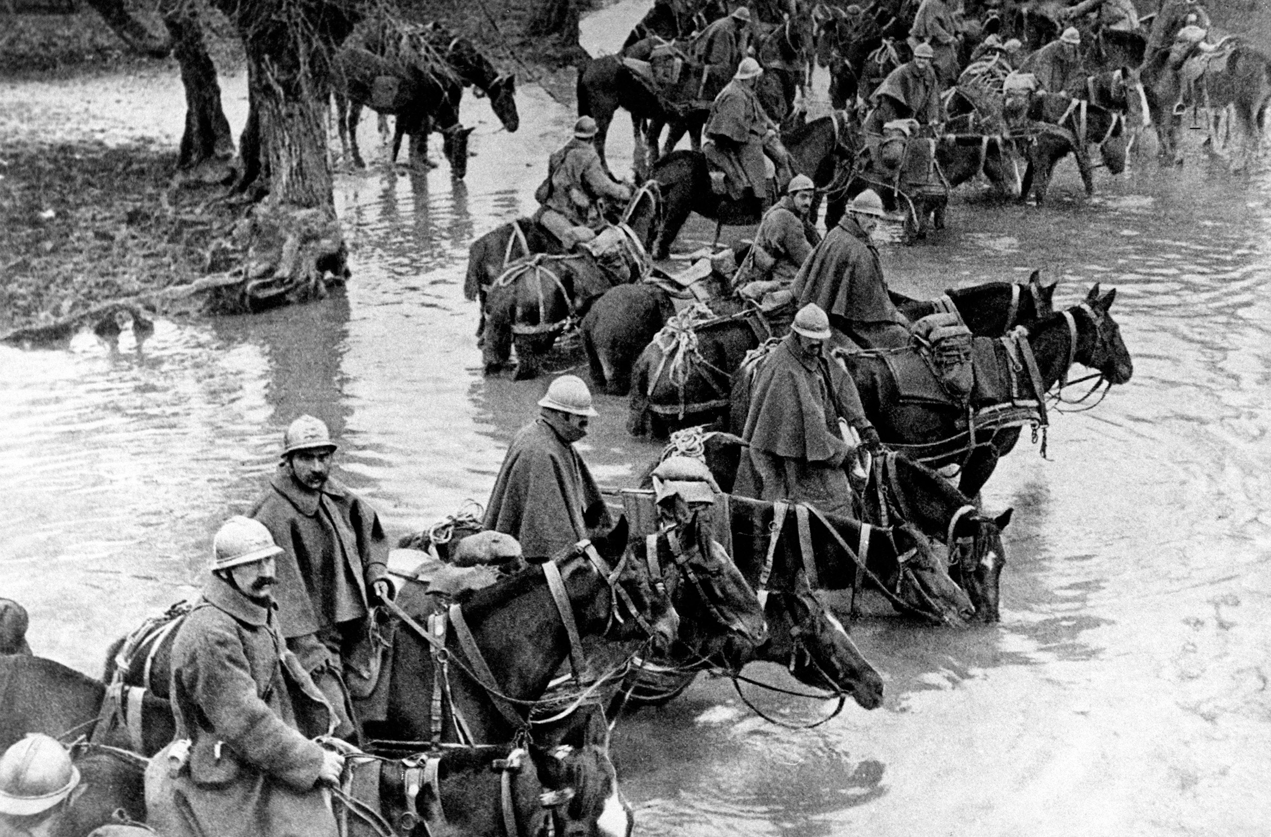 French mounted soldiers crossing a pond. Battle of Verdun, 1916.