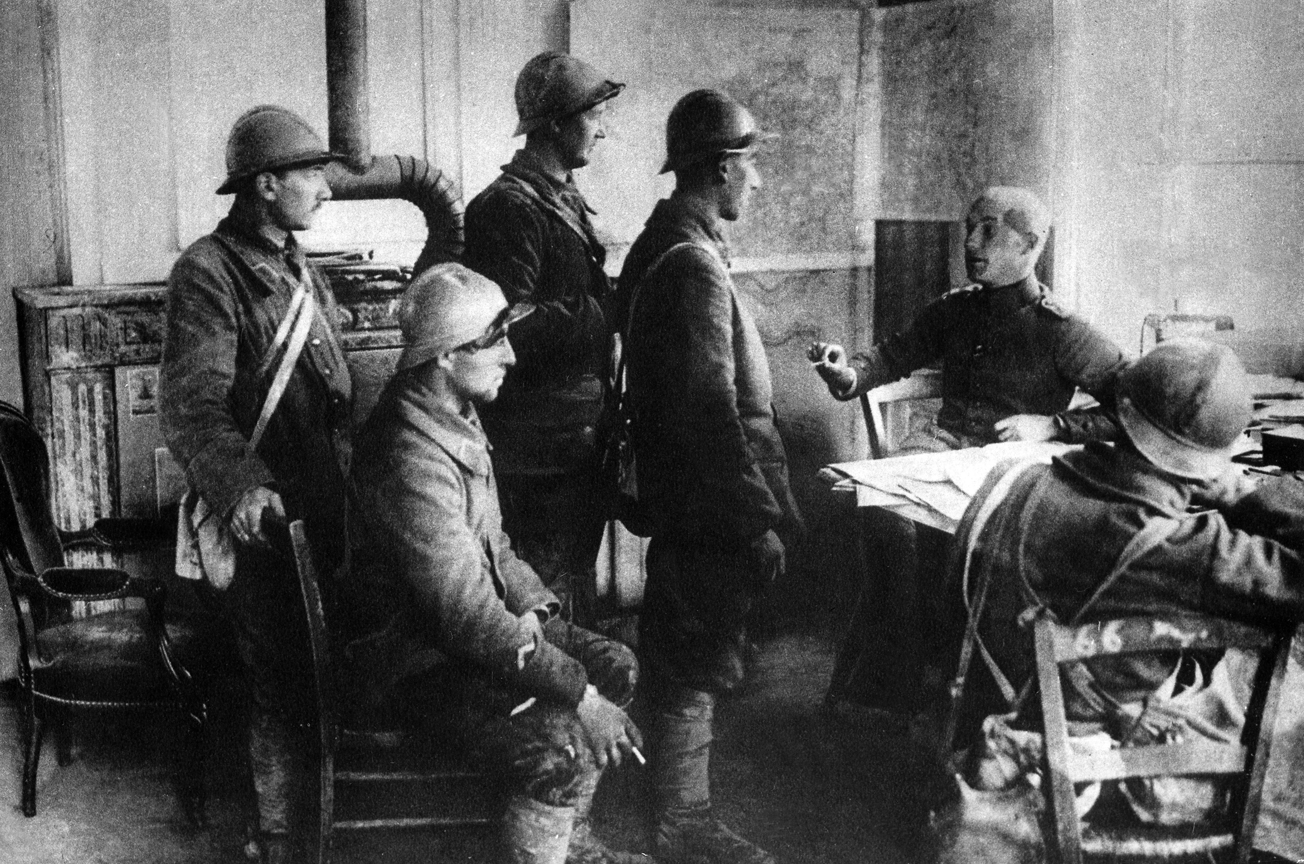 French soldiers taken prisoners during interrogation at a German staff quarter. April 1916, Battle of Verdun.