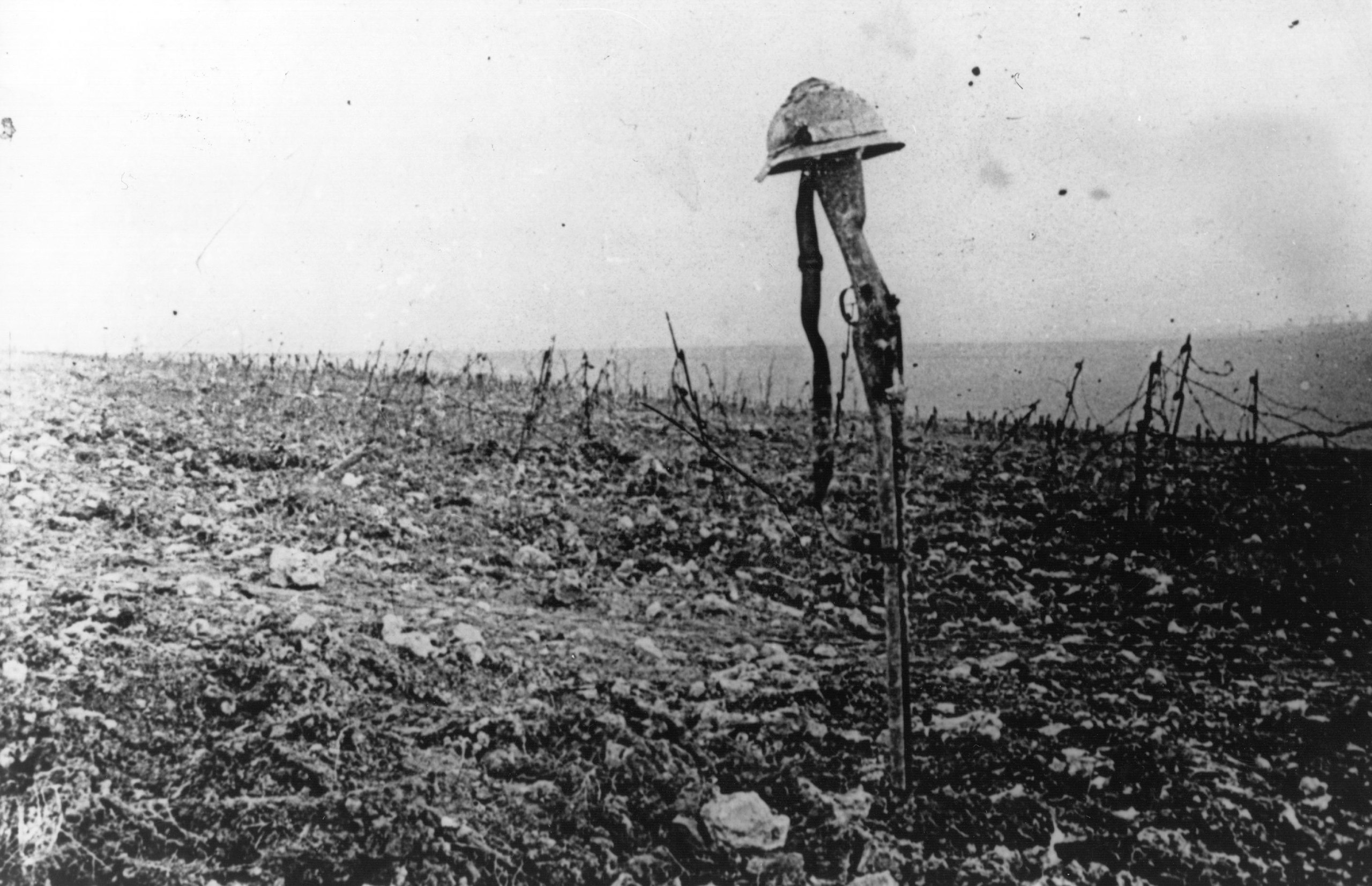 A French soldier's grave, marked by his rifle and helmet, on the battlefield of Verdun.