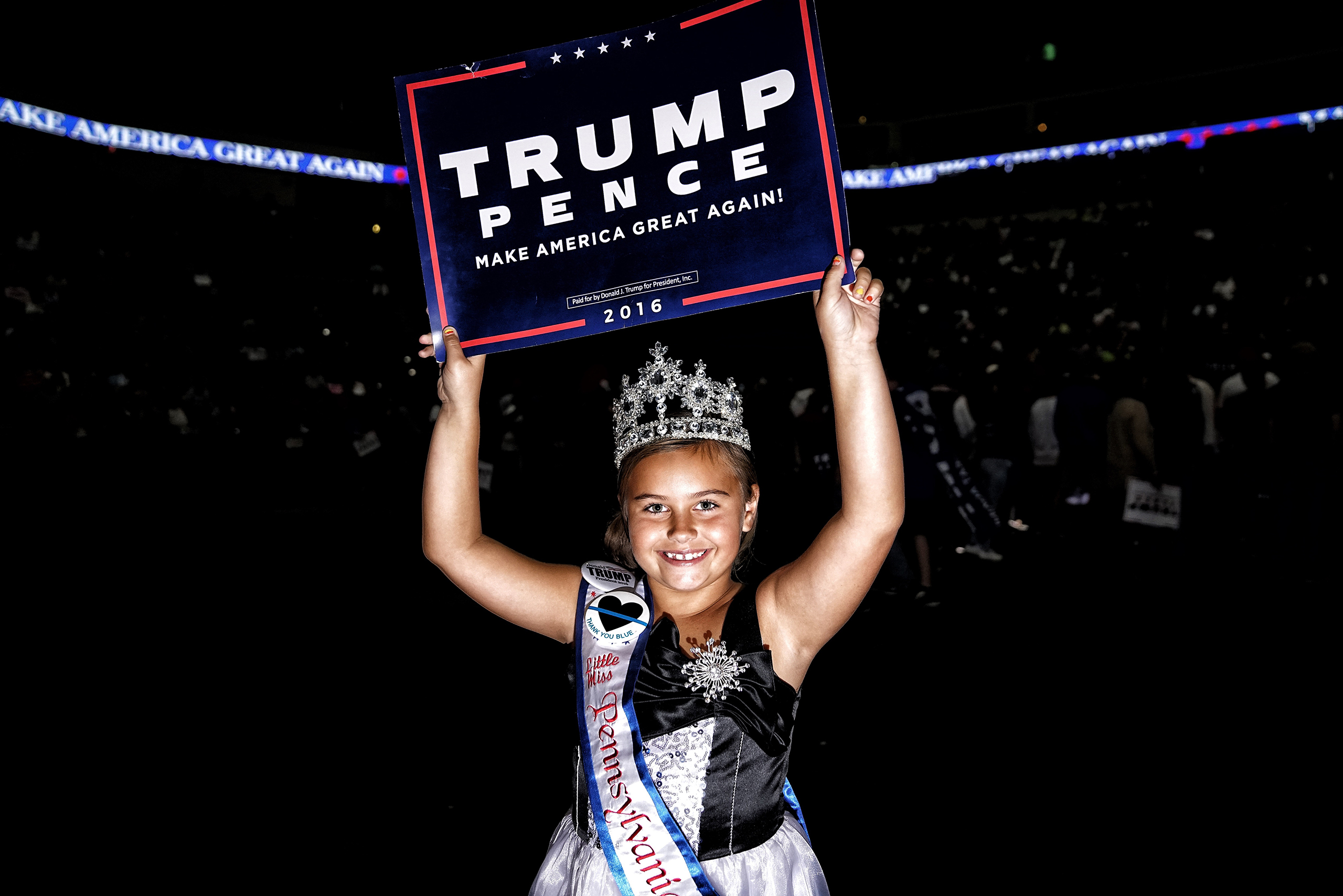 Little Miss Pennsylvania holds a campaign sign for Republican Presidential candidate Donald Trump at a rally on Nov. 4, 2016 in Hershey, Pa.