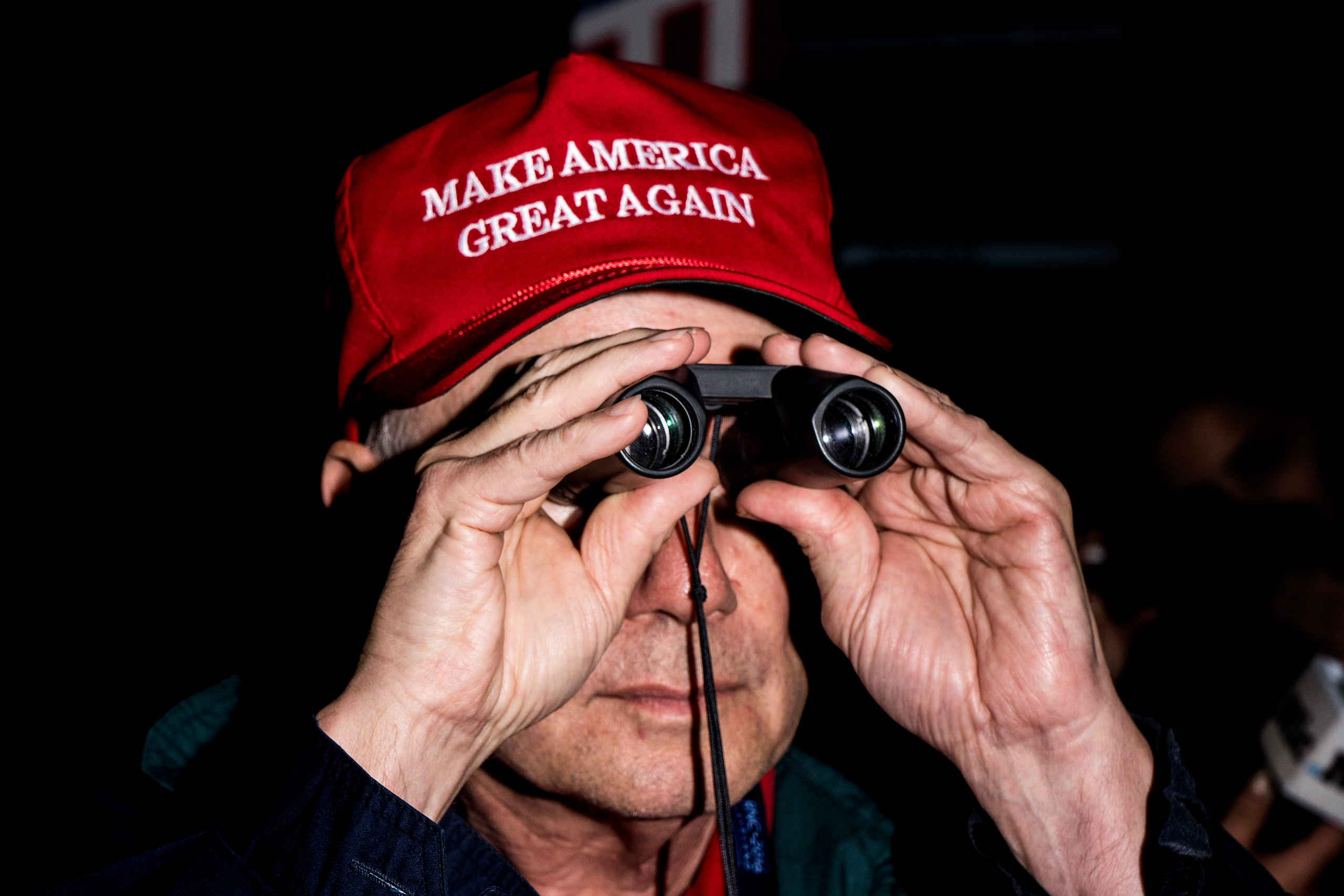 A man dons a  Make America Great Again  hat at the Republican National Convention in Cleveland, July 19, 2016.