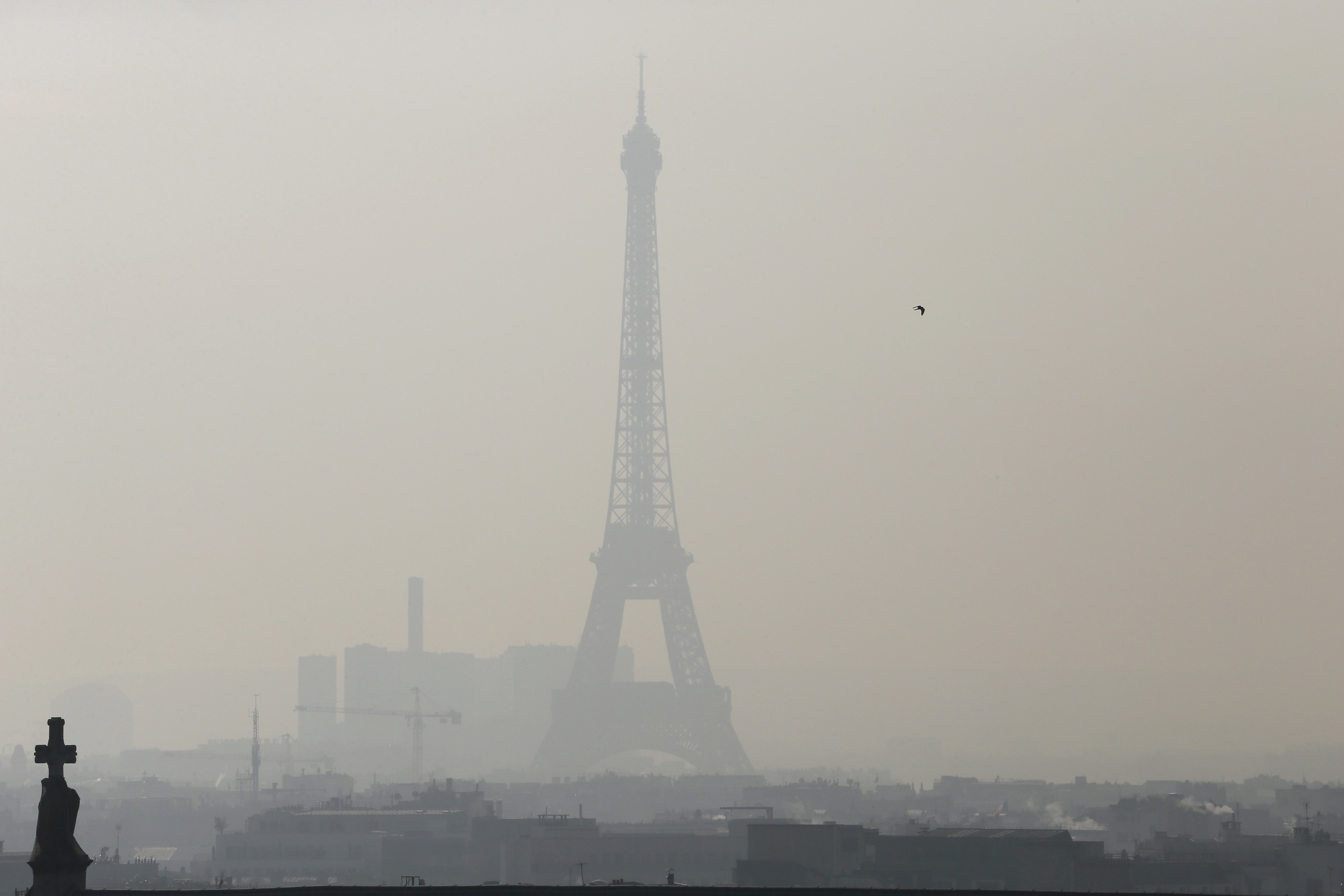 The Eiffel Tower through thick smog on February 12, 2015