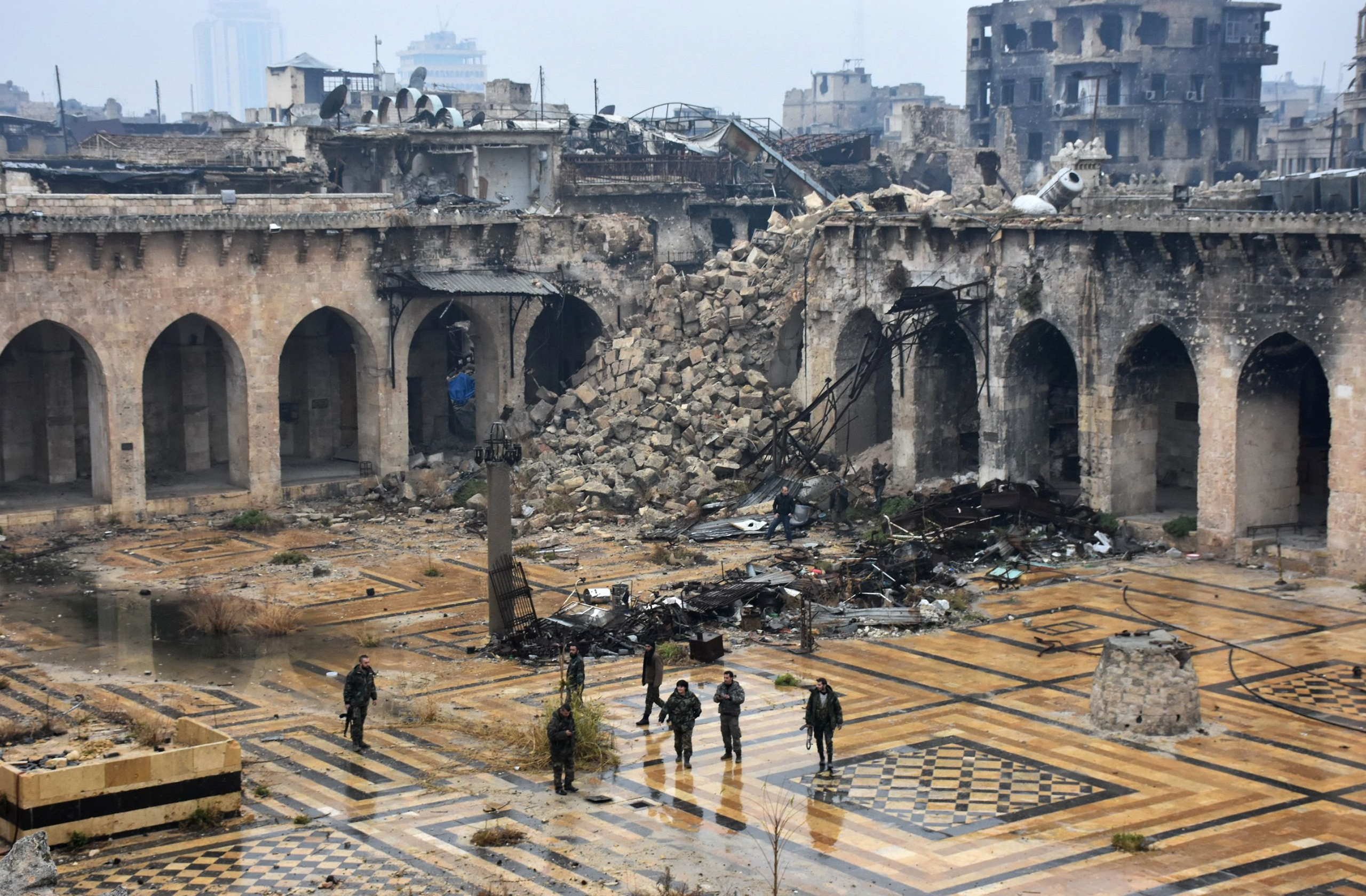 Syrian pro-government forces walk in the ancient Umayyad mosque in Aleppo after they captured the area on Dec. 13, 2016.