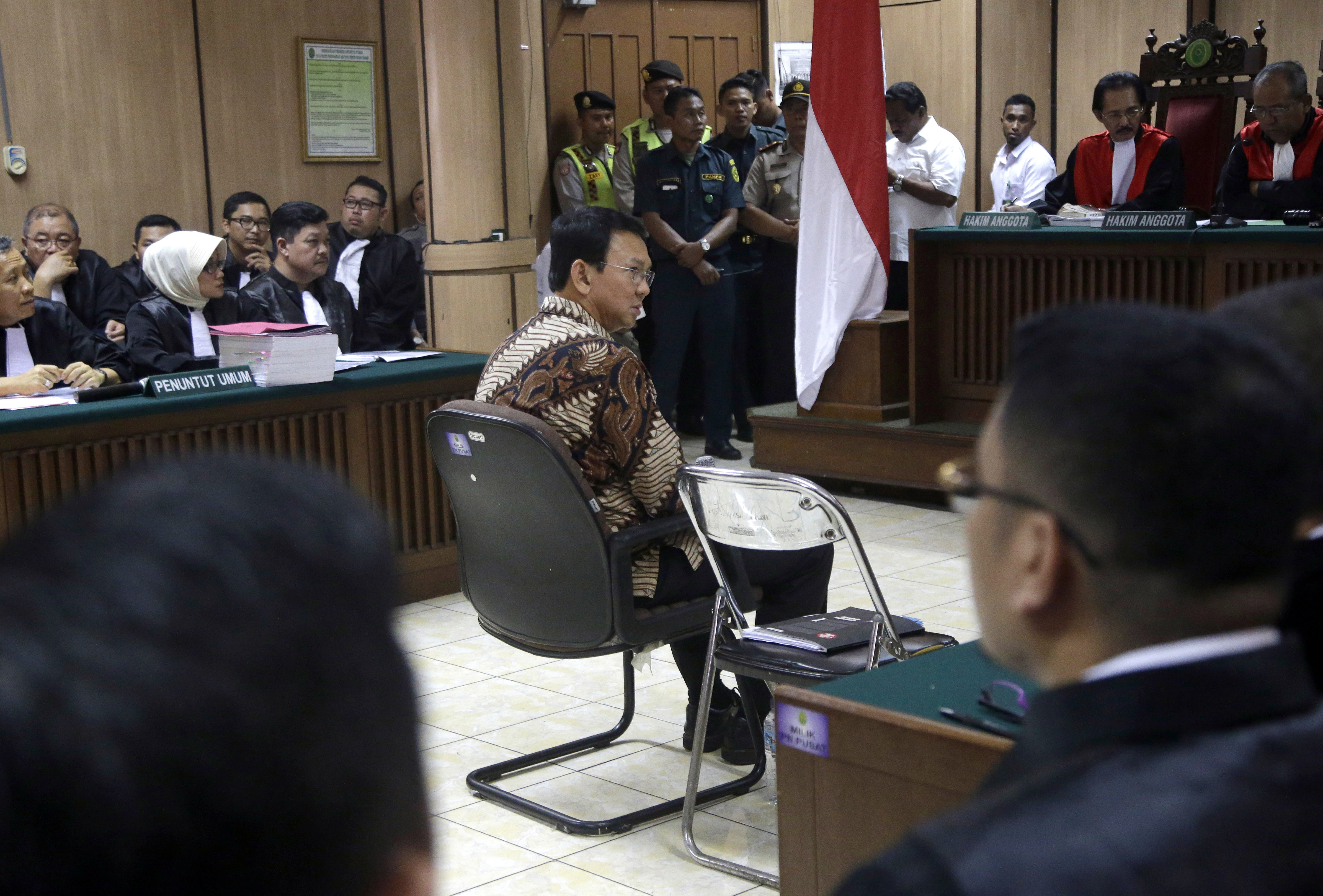 Jakarta Governor Basuki Tjahaja Purnama, popularly known as Ahok, center, sits on the defendant's chair at the start of his trial hearing at North Jakarta District Court in Jakarta on Dec. 13, 2016. Ahok is on trial on accusation of blasphemy following his remark about a passage in the Quran that could be interpreted as prohibiting Muslims from accepting non-Muslims as leaders
