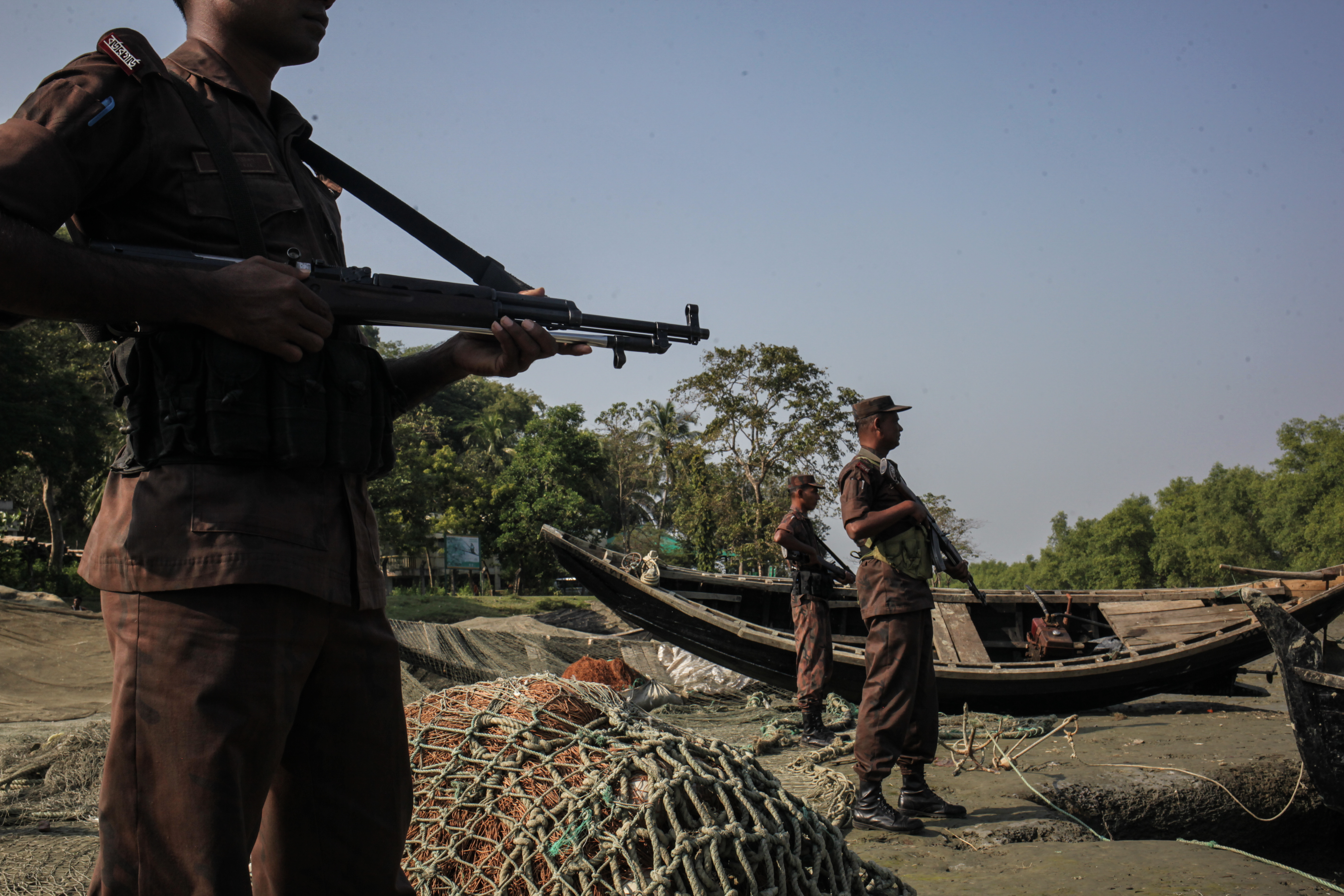 A patrol of Bangladeshi Border Guards attempts to prevent Rohingya refugees from crossing into Bangladesh from Burma, on the banks of the Naf River, near Cox's Bazar, Bangladesh, on Nov. 22, 2016