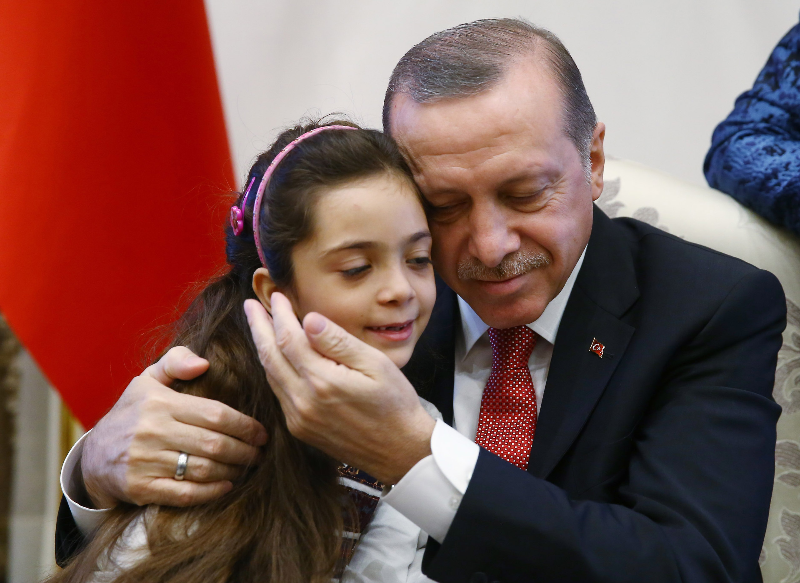 Turkish President Recep Tayyip Erdogan meets Syrian Bana Alabed, seven-year-old girl who tweeted on attacks from Aleppo, at Presidential Complex in Ankara, Turkey on December 21, 2016.