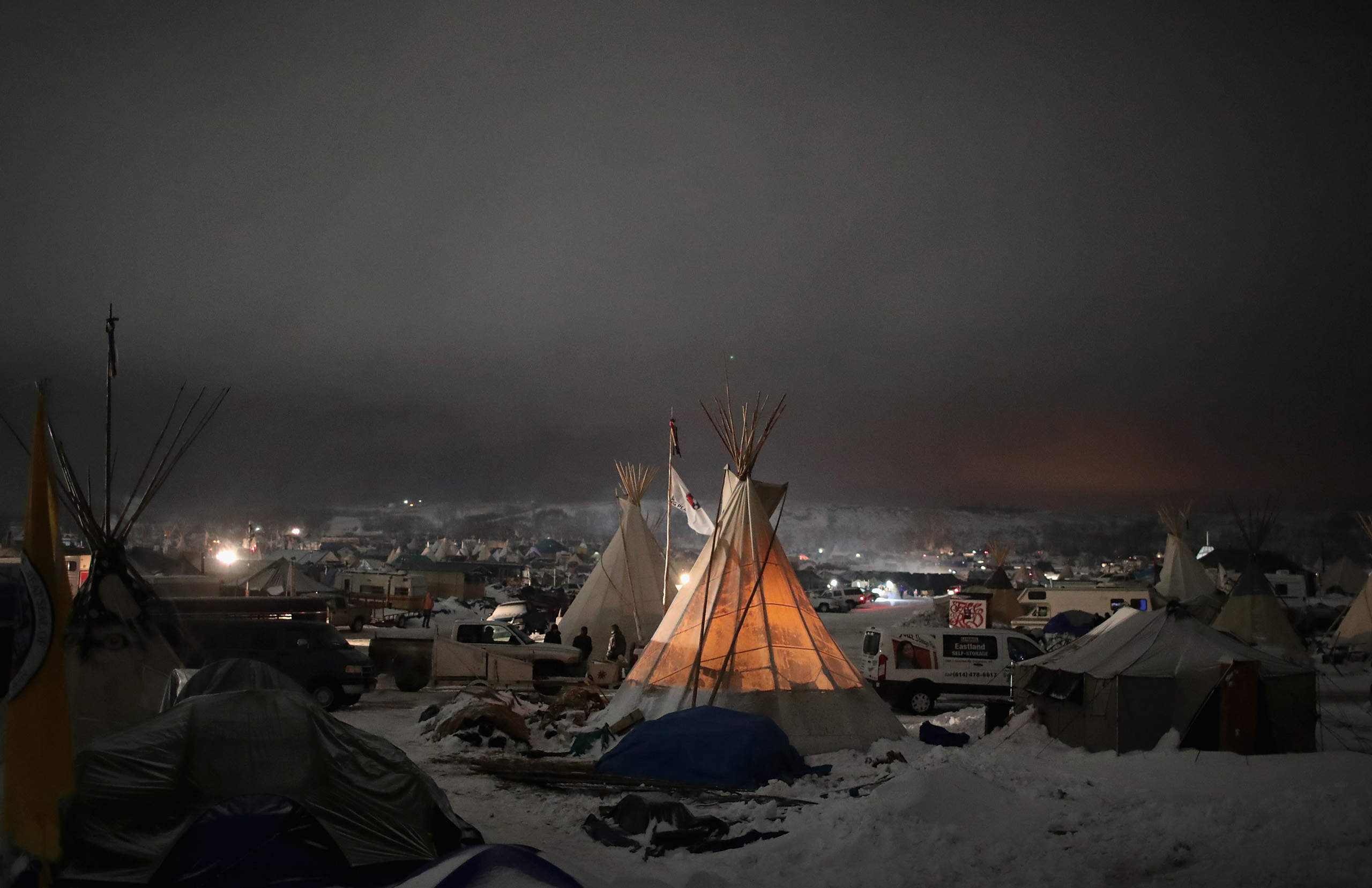 Night falls on Oceti Sakowin Camp on the edge of the Standing Rock Sioux Reservation outside Cannon Ball, North Dakota on Dec. 1, 2016