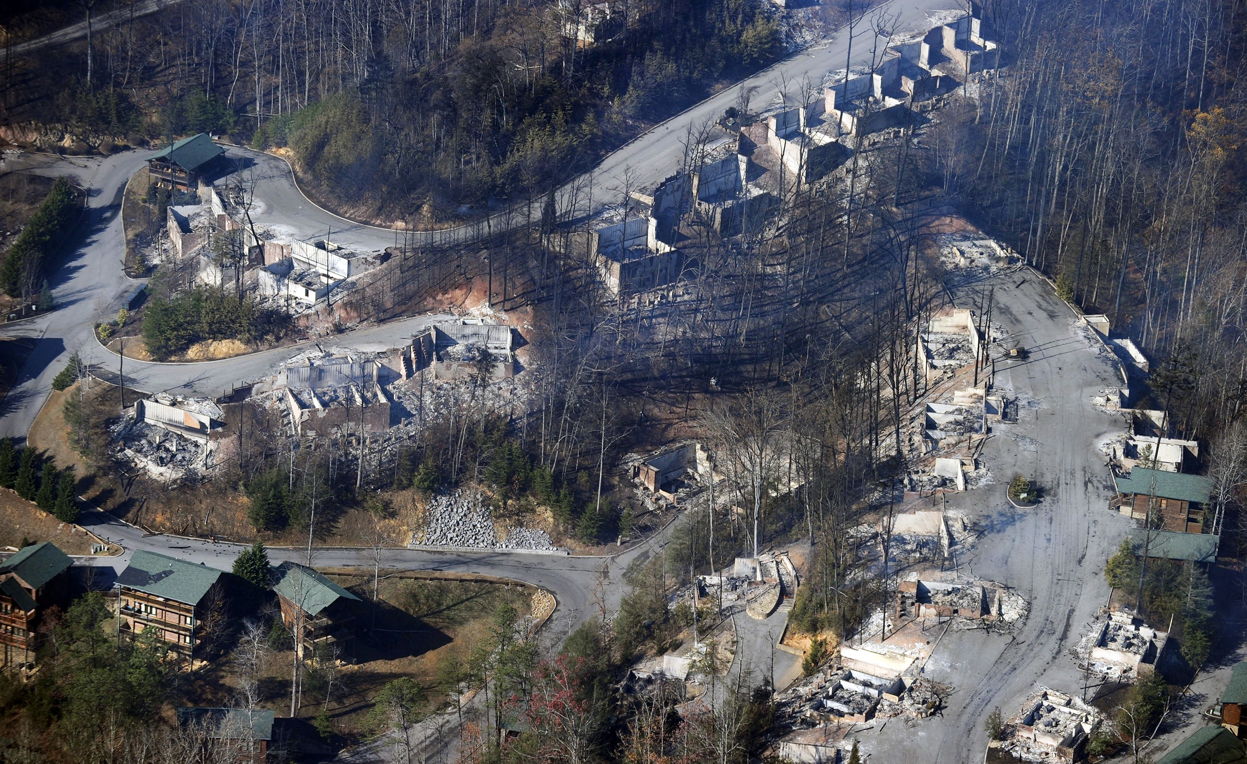 This aerial photo shows, destroyed homes, many burned down to the foundation the day after a wildfire in Gatlinburg, Tenn., on Nov. 29, 2016.