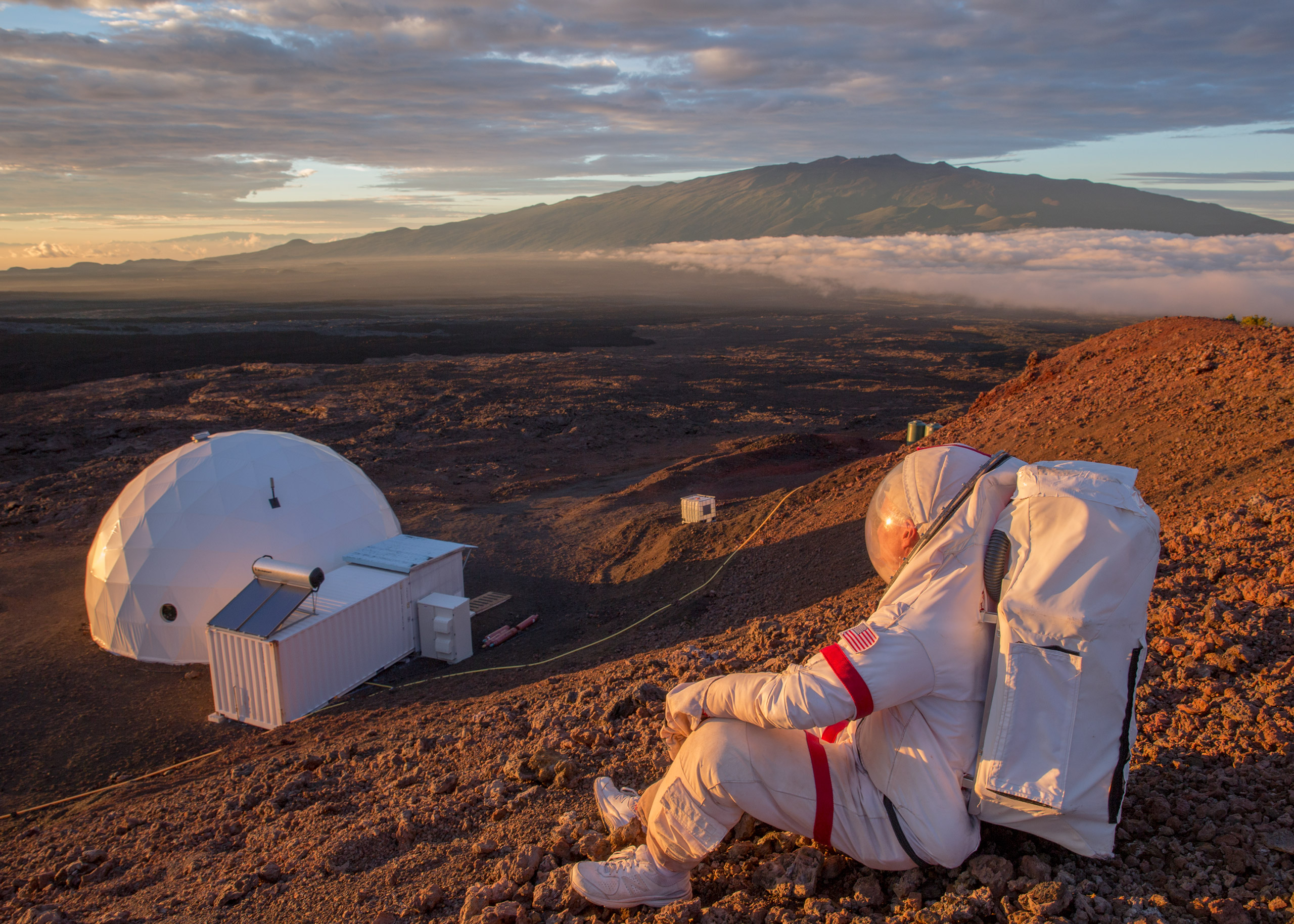 Jeffrey Kluger, TIME'S space writer, suited up as an astronaut would be, looks down at the HI-SEAS facility on Hawaii's Mauna Loa, Sept. 1, 2016. Kluger spent 24 hours inside NASA's Simulated Mars Base in Hawaii.From  My Day on Mars.  Sept. 26, 2016 issue.