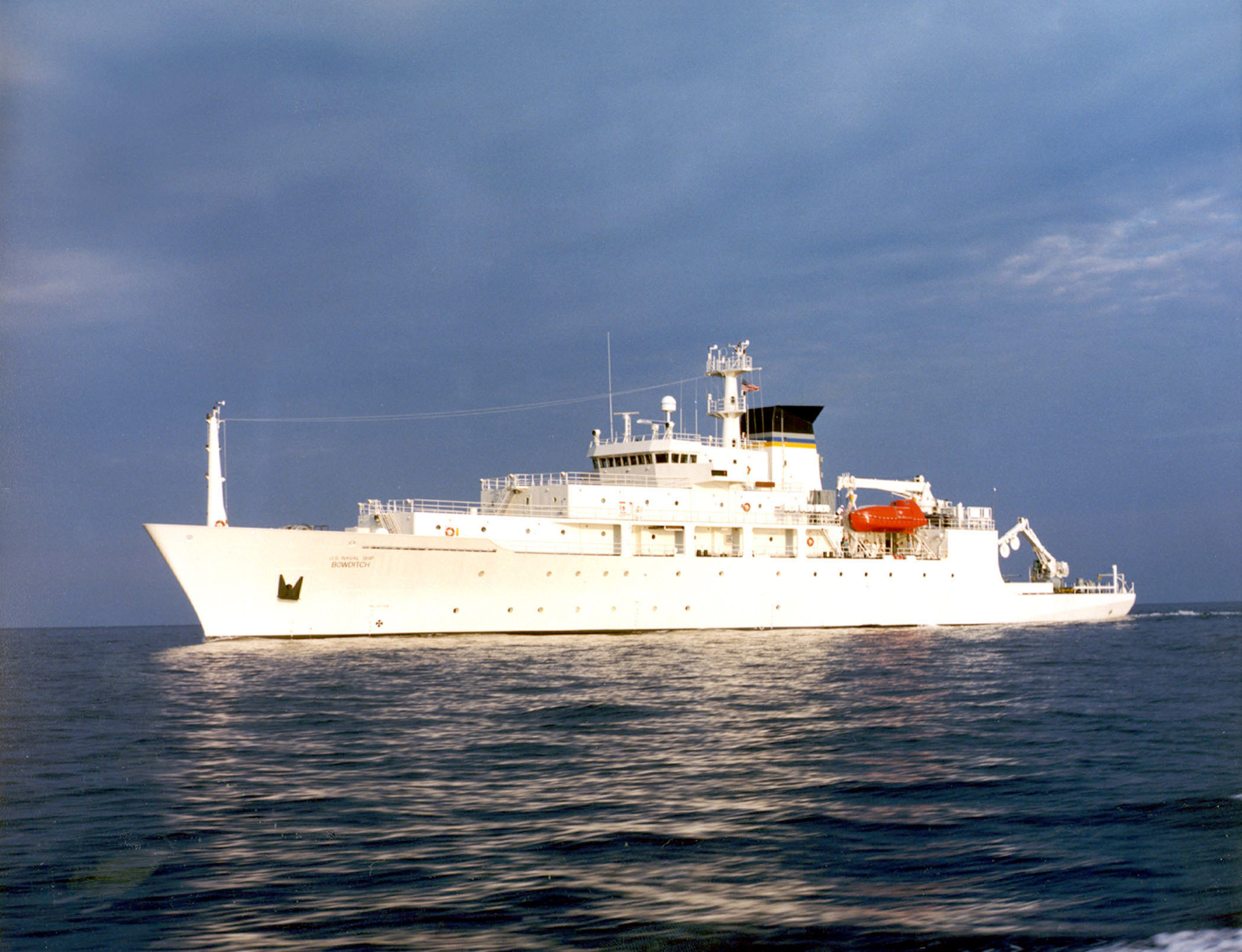 The USNS Bowditch, a T-AGS 60 Class Oceanographic Survey Ship, sails in open water.
