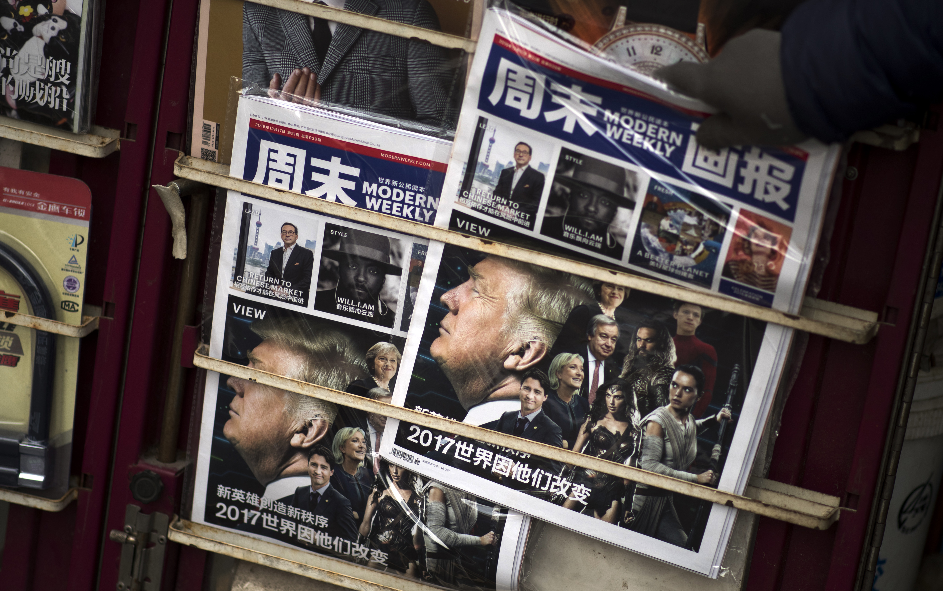 A Chinese magazine featuring US President-elect Donald Trump on the cover is seen at a newsstand in Shanghai on December 14, 2016.