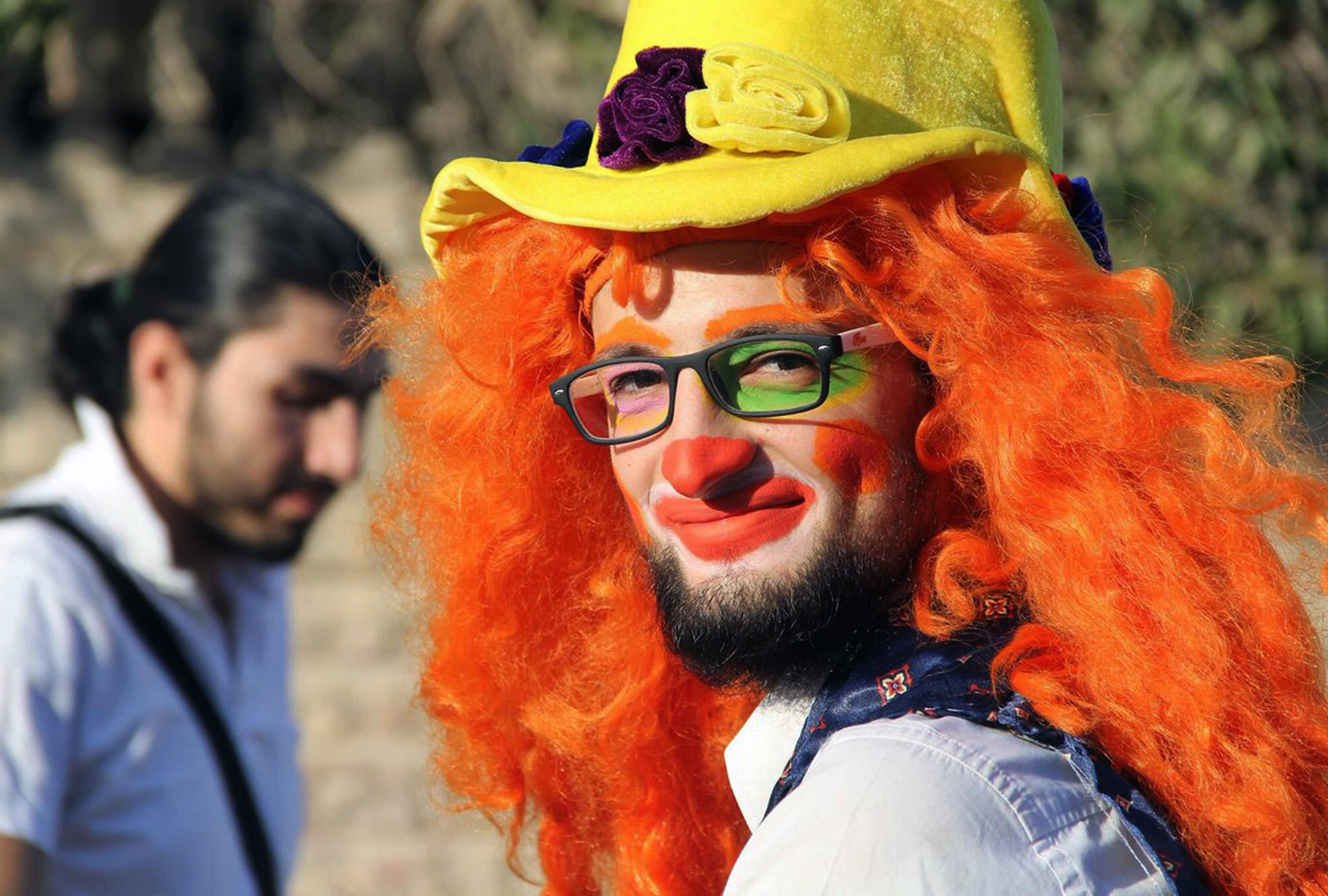 This undated photo courtesy of Ahmad al-Khatib, a media activist in Aleppo, shows Syrian social worker Anas al-Basha, 24, dressed as a clown, while posing for a photograph in Aleppo, Syria.